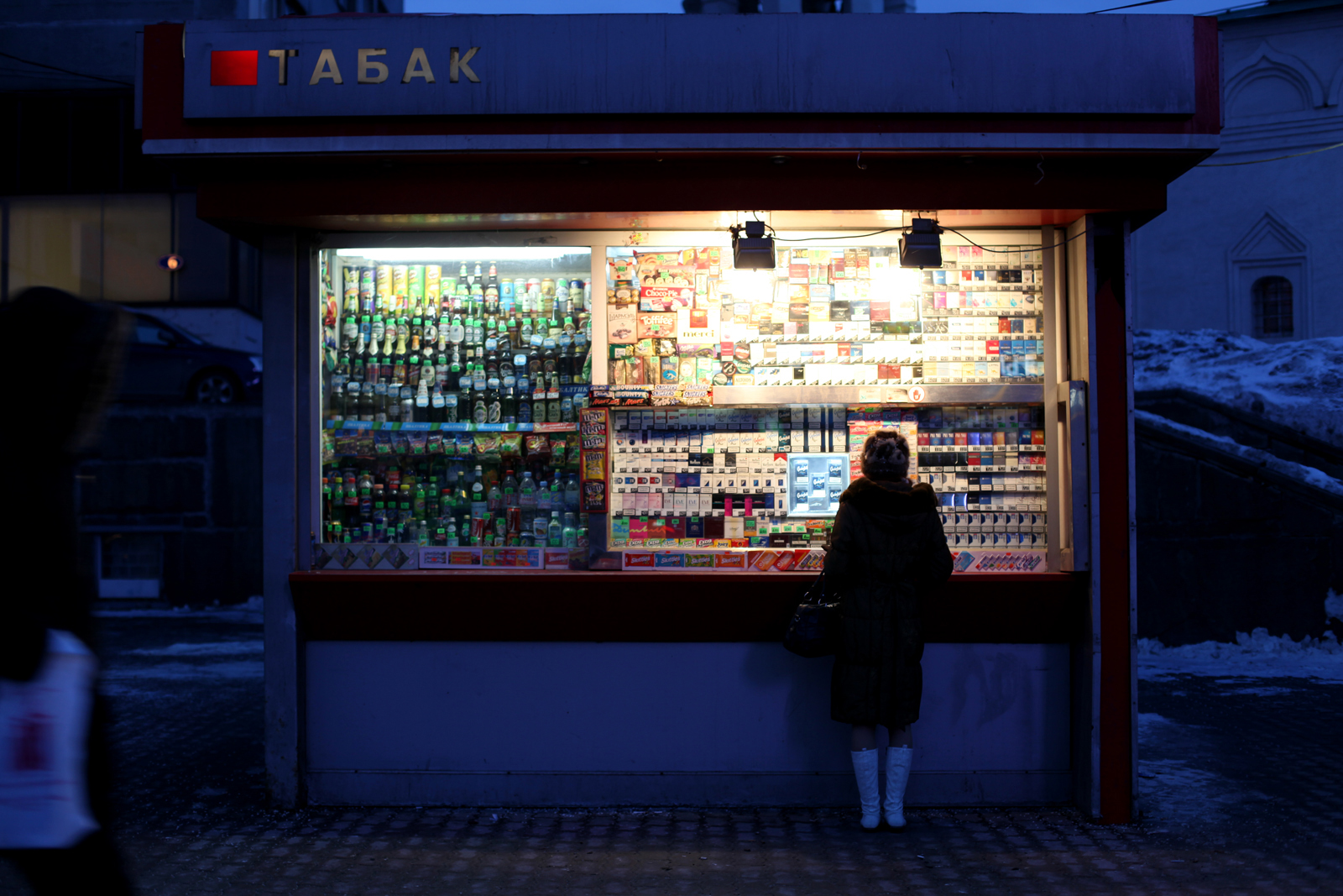 A sidewalk shop selling cigarettes, alcohol, and snacks, Moscow, Russia