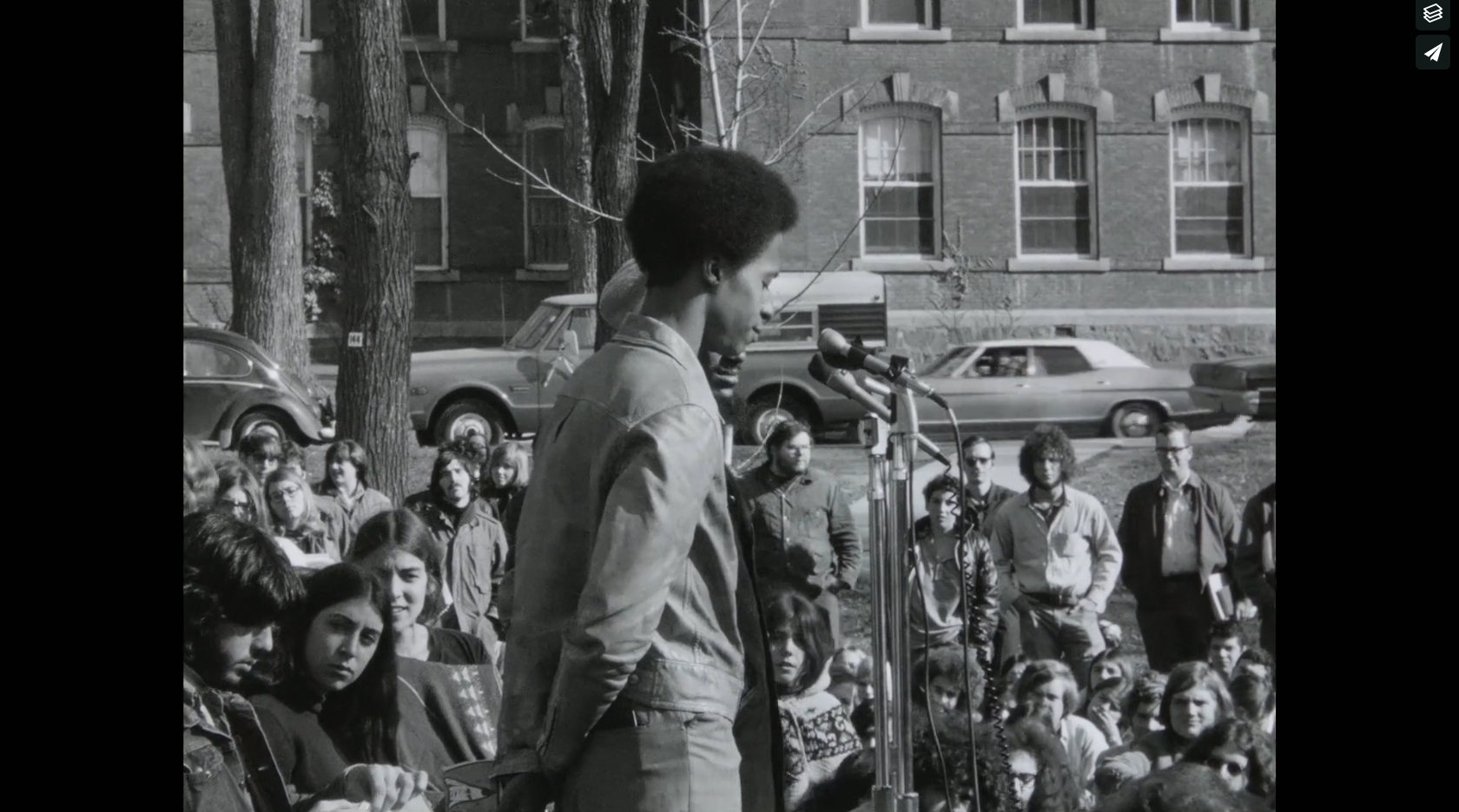 BLACK PANTHER RALLY AT THE UNIVERSITY OF VERMONT   16mm Footage from early 1970s - Black Panther rally on the University of Vermont green. B-roll footage, no audio, B&W     Click the image to view