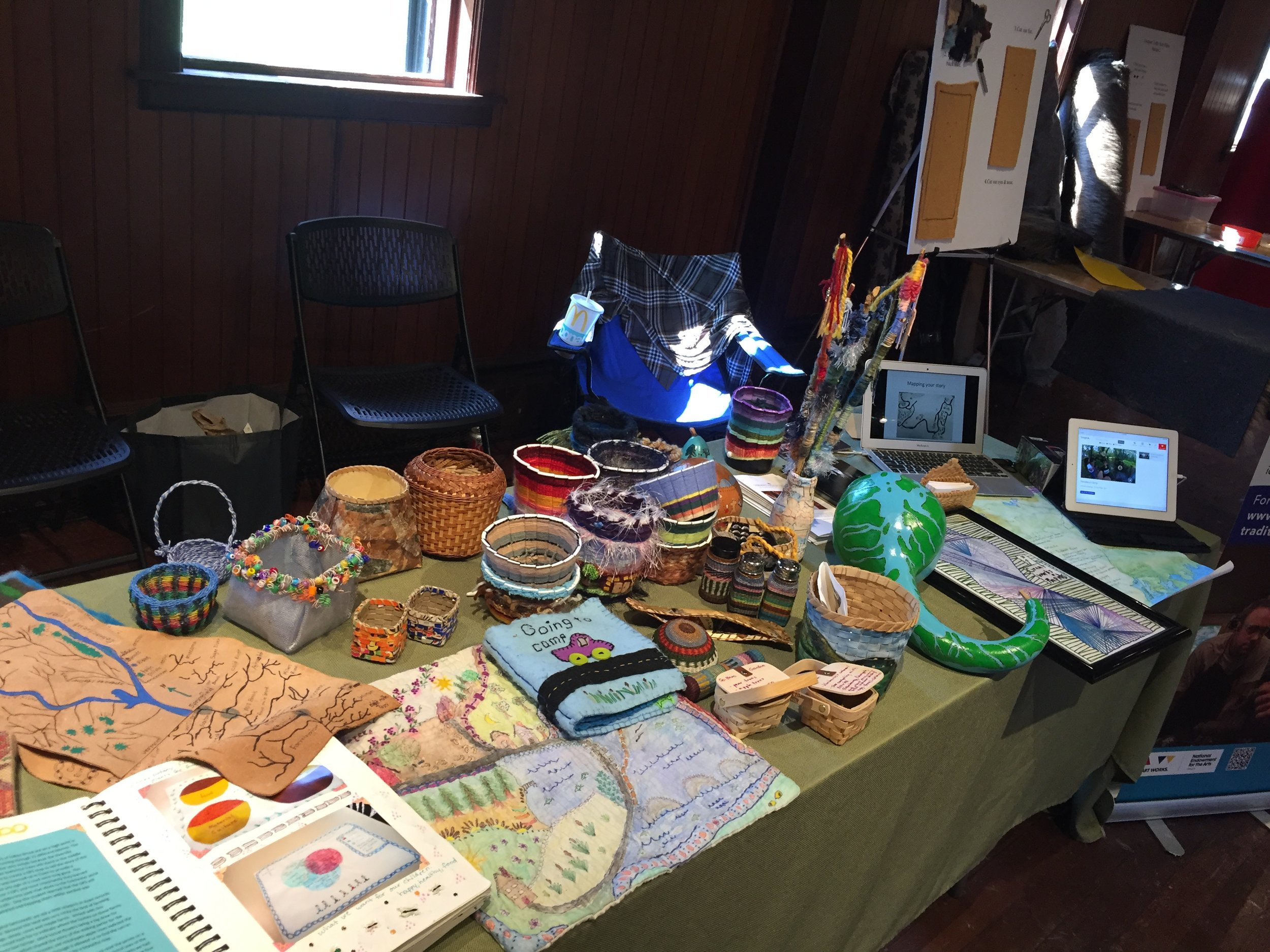 A selection of Judy's baskets and her students' maps.