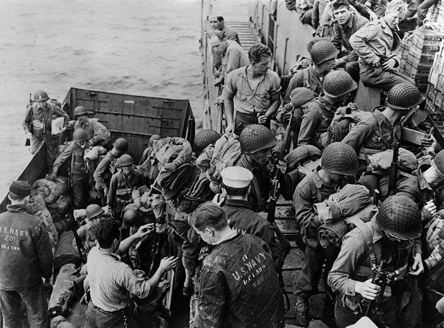 Landing craft : 4th Infantry Division Soldiers work with the Navy during amphibious training exercises in Southern England, March 1944.