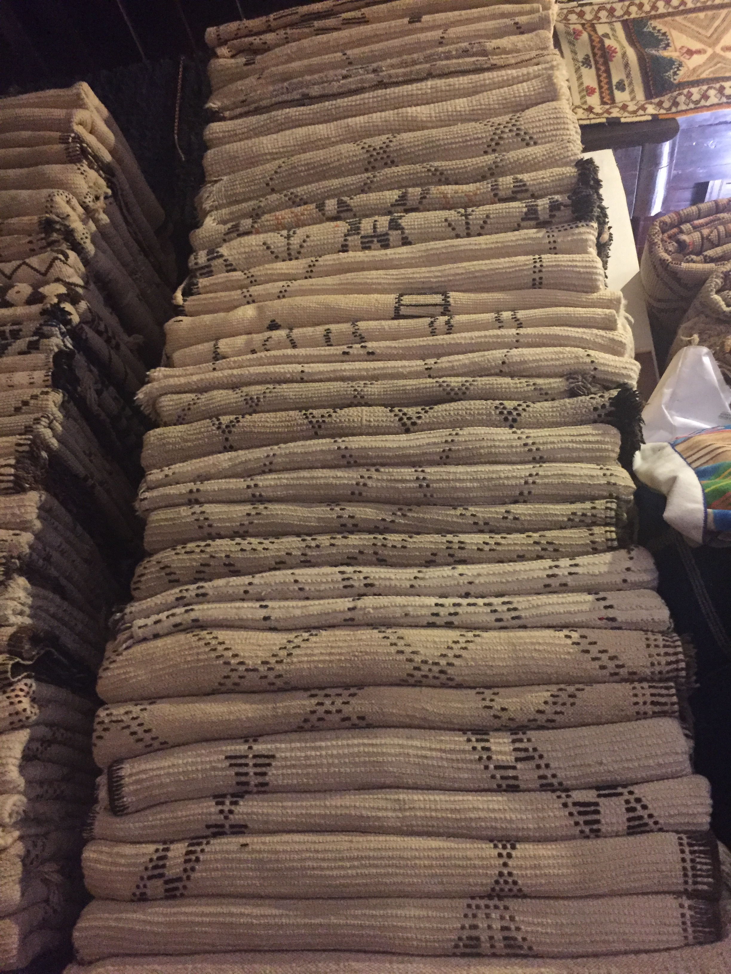 Big stack of Beni Ourain Berber rugs, some headed to Toronto, Canada.