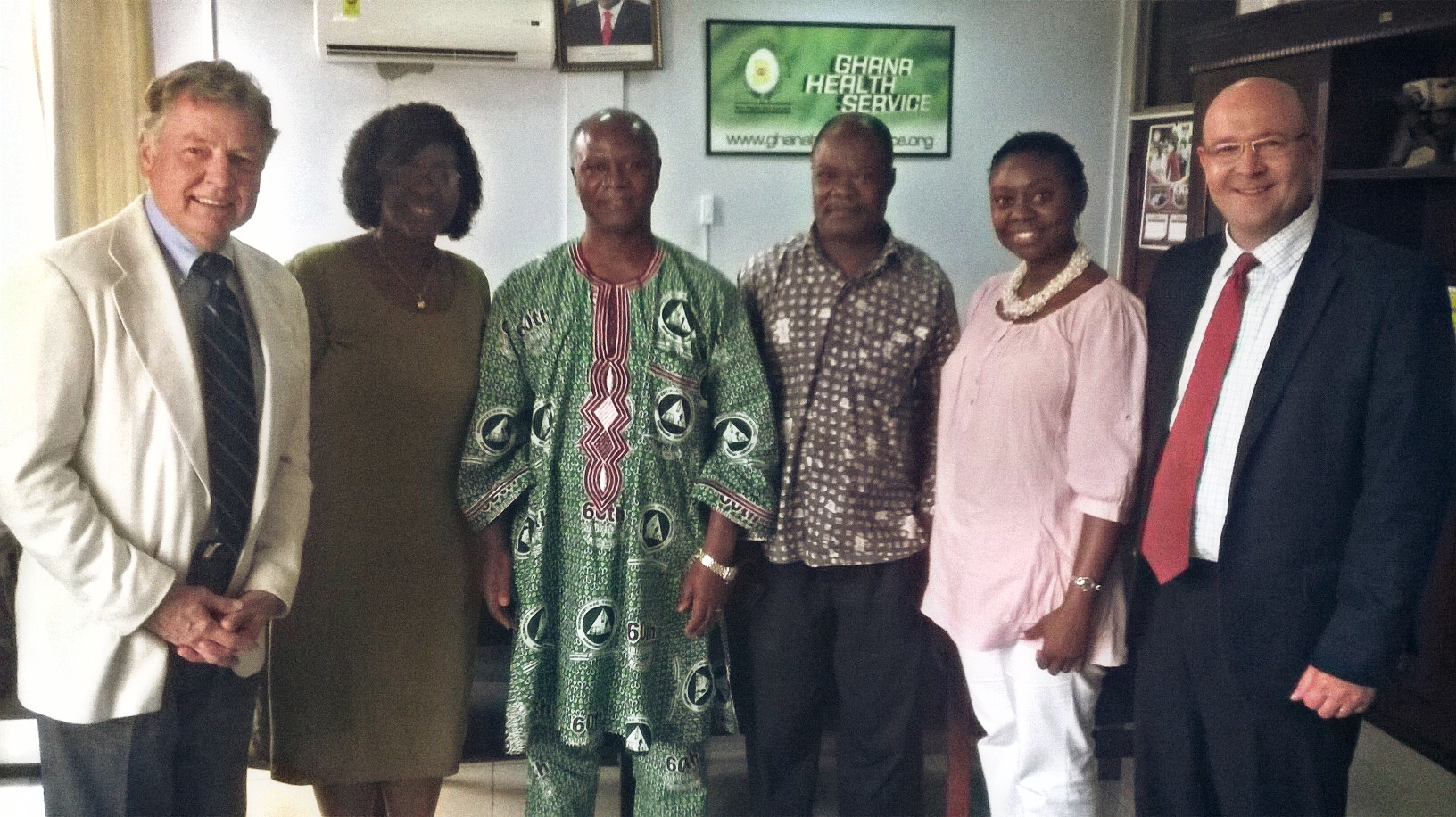 PMMI CEO Tom Petersen (far left) meeting with Ghanaian health officials and doctors.