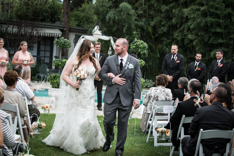 realwedding_backyard_ceremony_couple_aisle_redlands