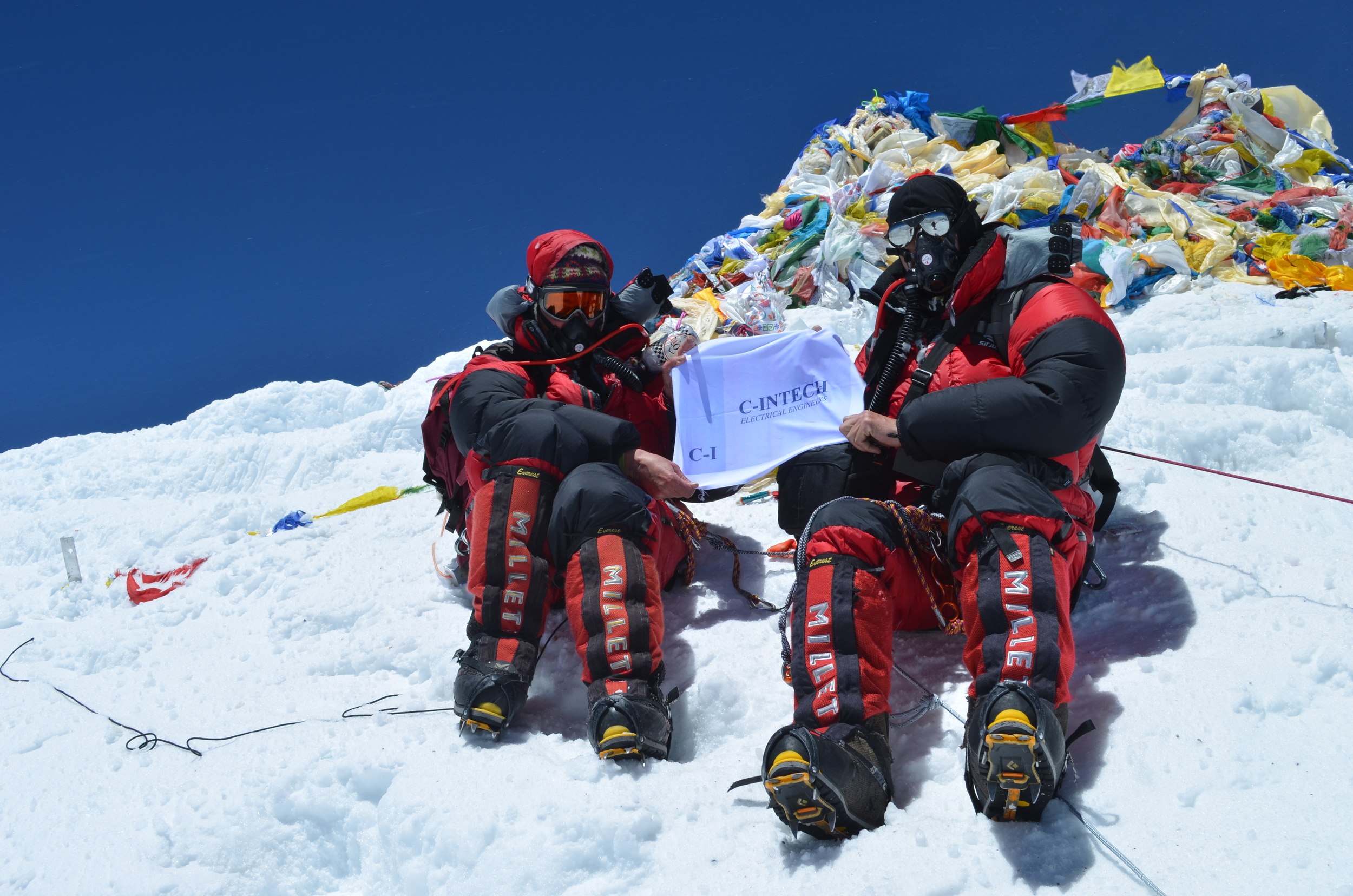 C-INTECH company flag on the summit of Mt Everest