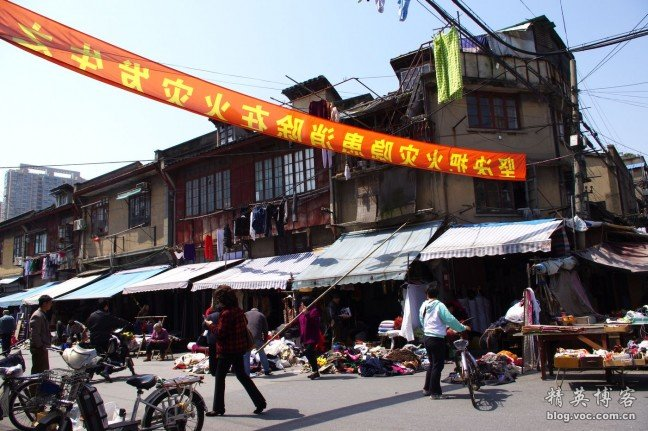A lively street in a haphazardly planned Shanghai neighborhood.