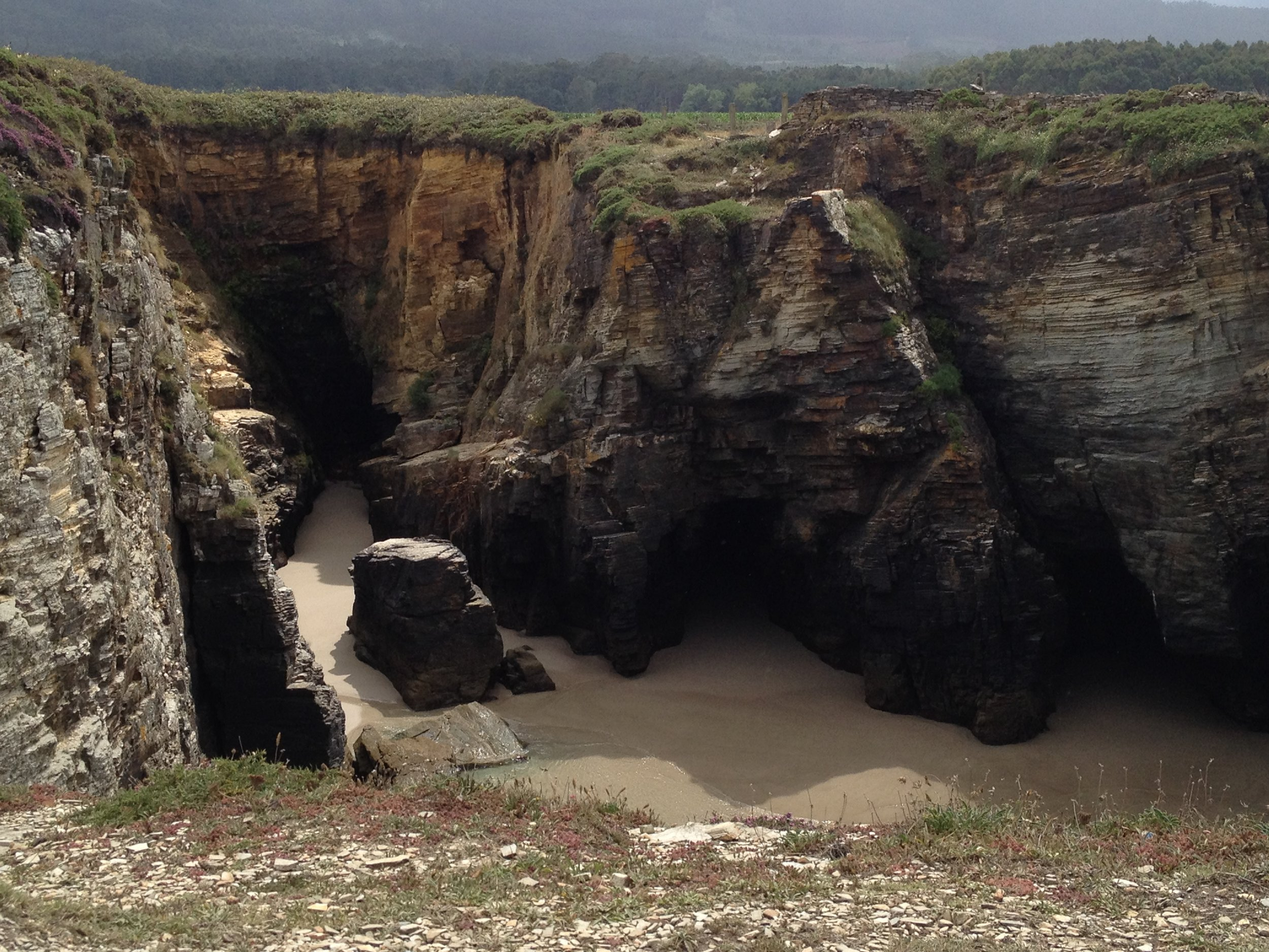 Walking along the path above we got a bird's-eye view of the rock formations and caves carved out by the powerful surf.