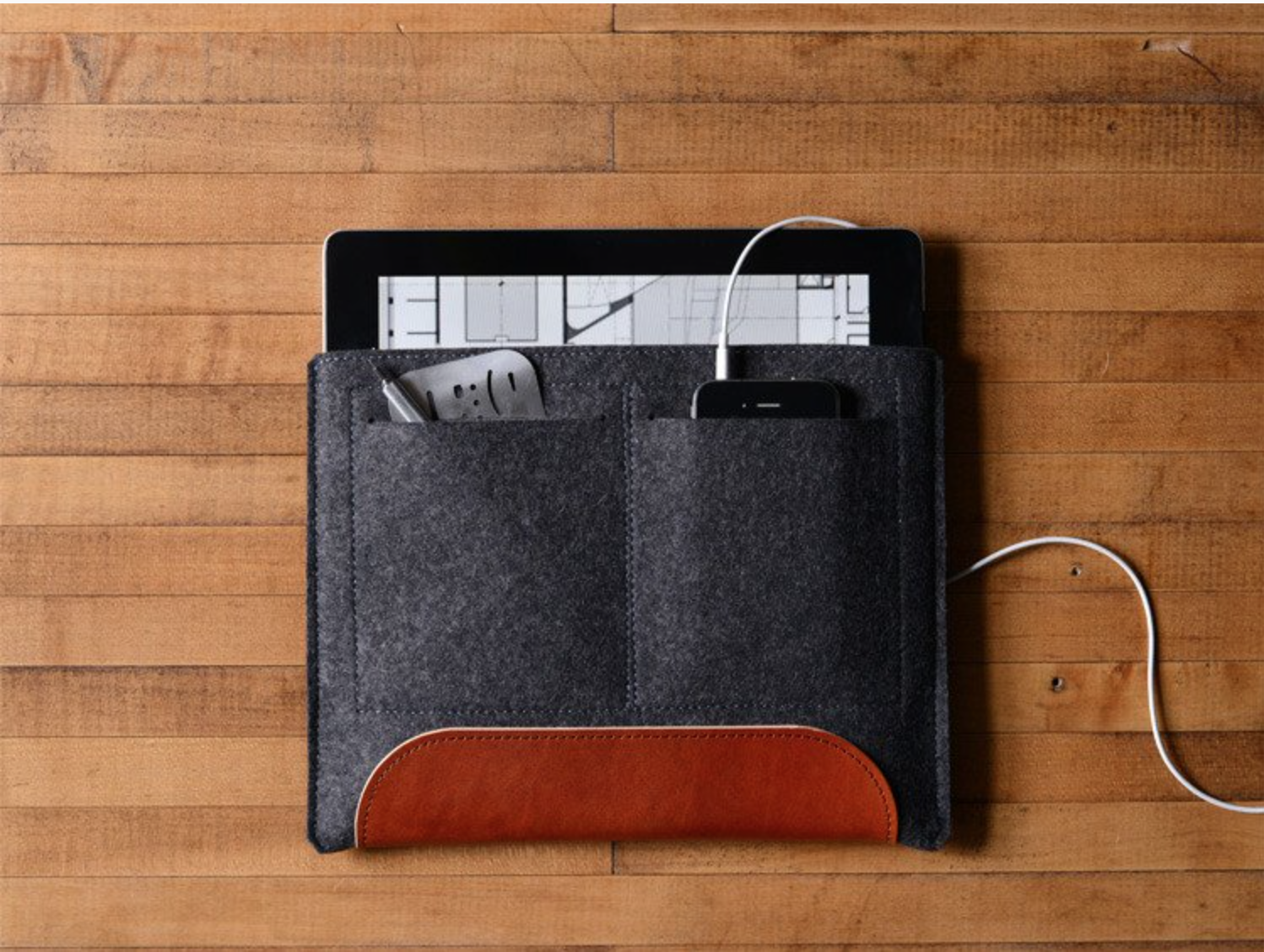 I found Byrd and Belle a few years ago when I was looking for a sleeve for my iPad. The leather accent is beautiful and I get compliments everywhere I go. I just ordered this iPhone sleeve/wallet for my recently purchased iPhone 5C. The leather fits 4-5 cards on each side, great for clubbing! Can't wait to get it in the mail!  www.byrdandbelle.com