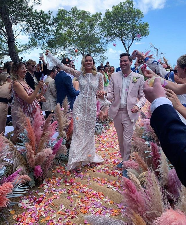 Congrats to the beautiful @emily_letts_ who got married last weekend in paradise! Just look at all that colour 💐⠀⠀⠀⠀⠀⠀⠀⠀⠀ Gown by @j.andreatta_