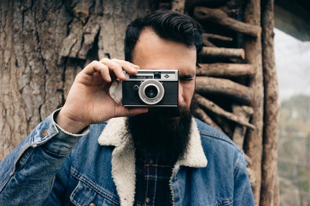 man-camera-woods