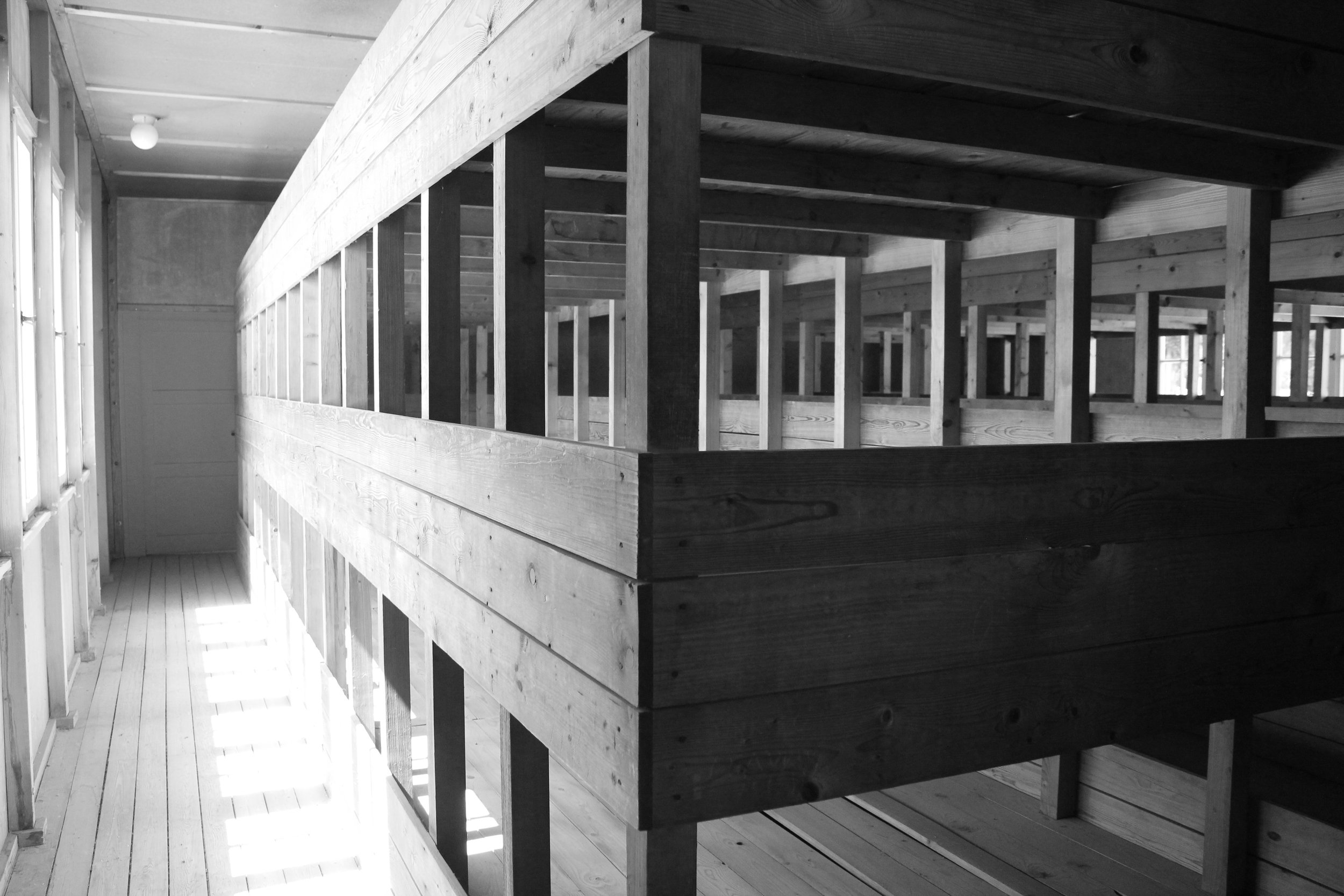 """These beds were for the """"lower class"""" prisoners. Hundreds of people would share these beds, they would barely get any food so they would get weak and they couldn't climb to the upper beds, they would pile onto the bottom bunk or just sleep on the floor."""