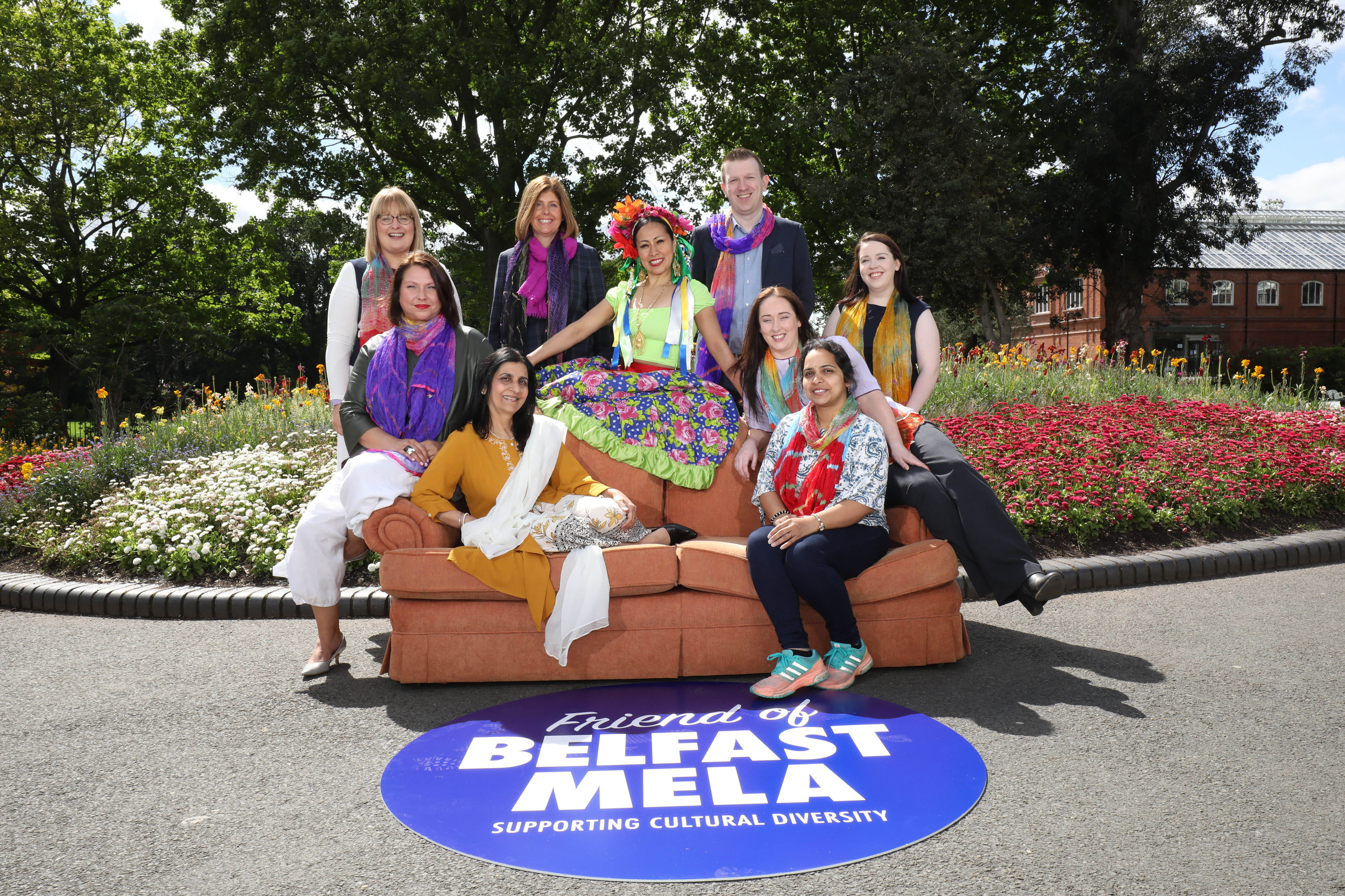 Friends of Belfast Mela gathered in Botanic Gardens to launch ArtsEkta's new diversity initiative. Pictured (l to r - back row) are Gillian Orr, Phoenix Natural Gas; Claire McBride, Olenick; Caroline van der Feltz, Danske Bank; Mexican dancer Mayte Segura; John Boyd, Hannon Travel; Kelly Clifford, First Trust and Ciara Smyth, Belfast Harbour with Nisha Tandon, ArtsEkta and Annapurna Nallaka, AllState seated on the 'Friends' sofa. (©Press Eye/Darren Kidd)