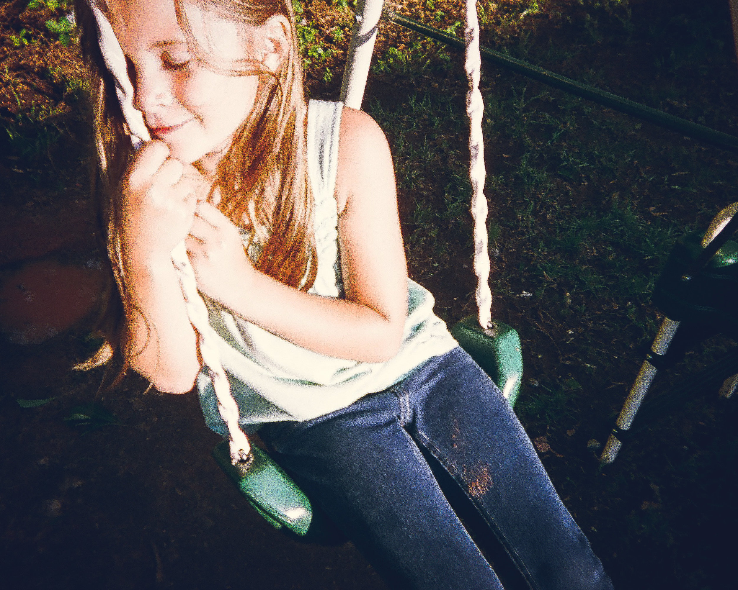"""Lyric on the Swings  by Cierra Driggers   """"The smile on her face was right after she fell off the steps. I helped her up and asked her to come swing with me and she put her head down and smiled and I took a picture of her."""""""