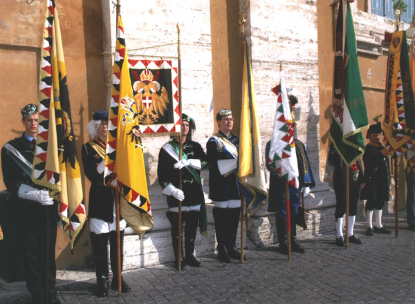 An honor guard with standards and uniforms from the old Austro-Hungarian Empire await the Pope.