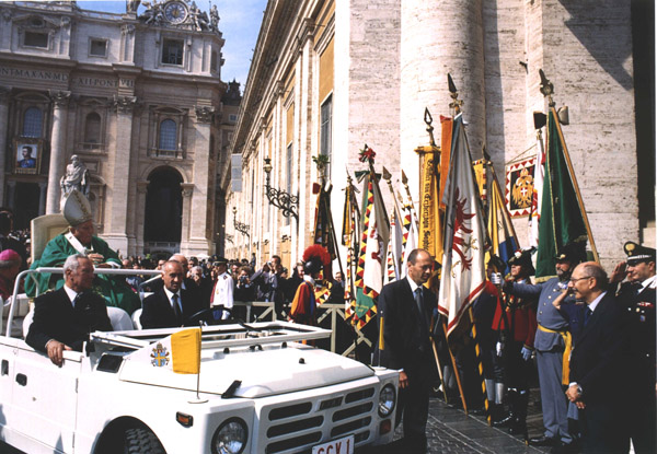 The Holy Father passes an honor guard with standards and uniforms from the old Austro-Hungarian Empire.