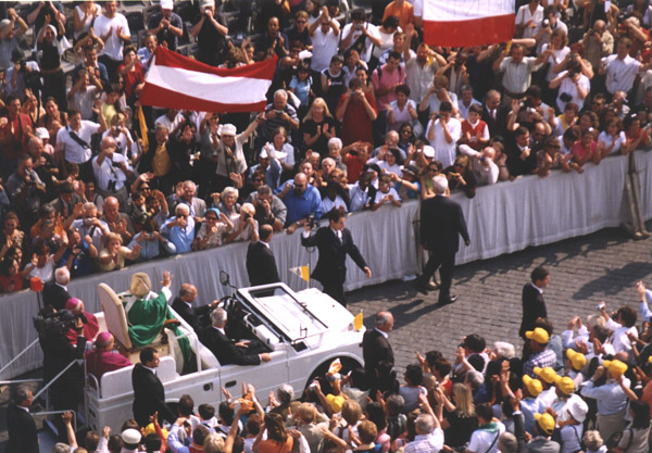 The Holy Father passes through the crowd after the Beatification Mass.