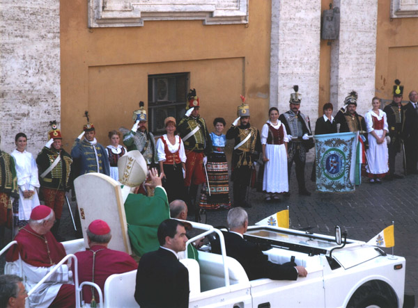 As the Holy Father leaves Saint Peter's Square, he passes a group of Hungarian Hussars and their spouses.