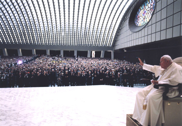 Pope John Paul II enters the Audience Hall of Paul VI.
