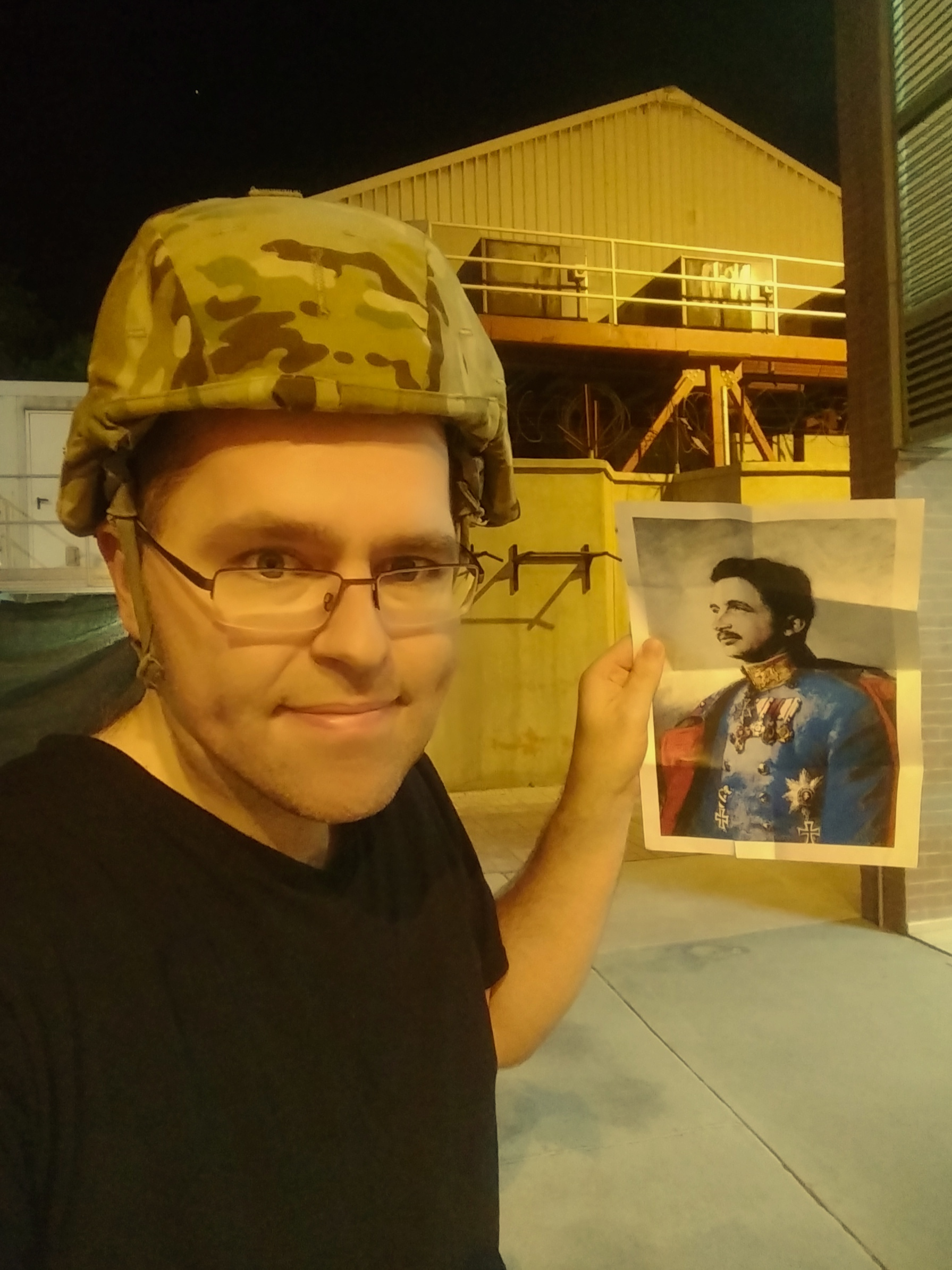 Patrick Abbott, Financial Secretary to O'Boyle Council 11302 and acting Roundtable Chairman, is shown in Kabul, Afghanistan, with his image of Blessed Karl during a recent deployment.