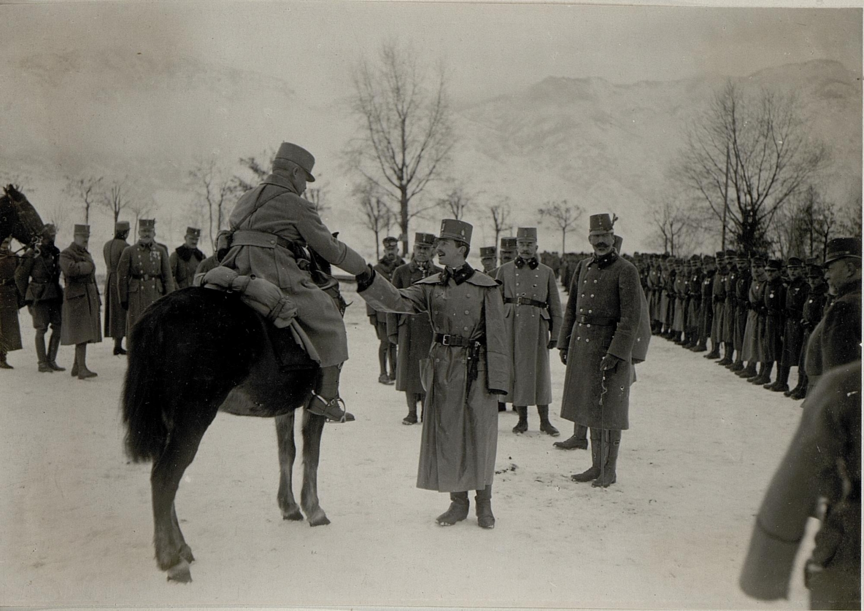 Karl warmly shakes hands with a soldier during a visit to front lines in Levico, Italy in 1917.