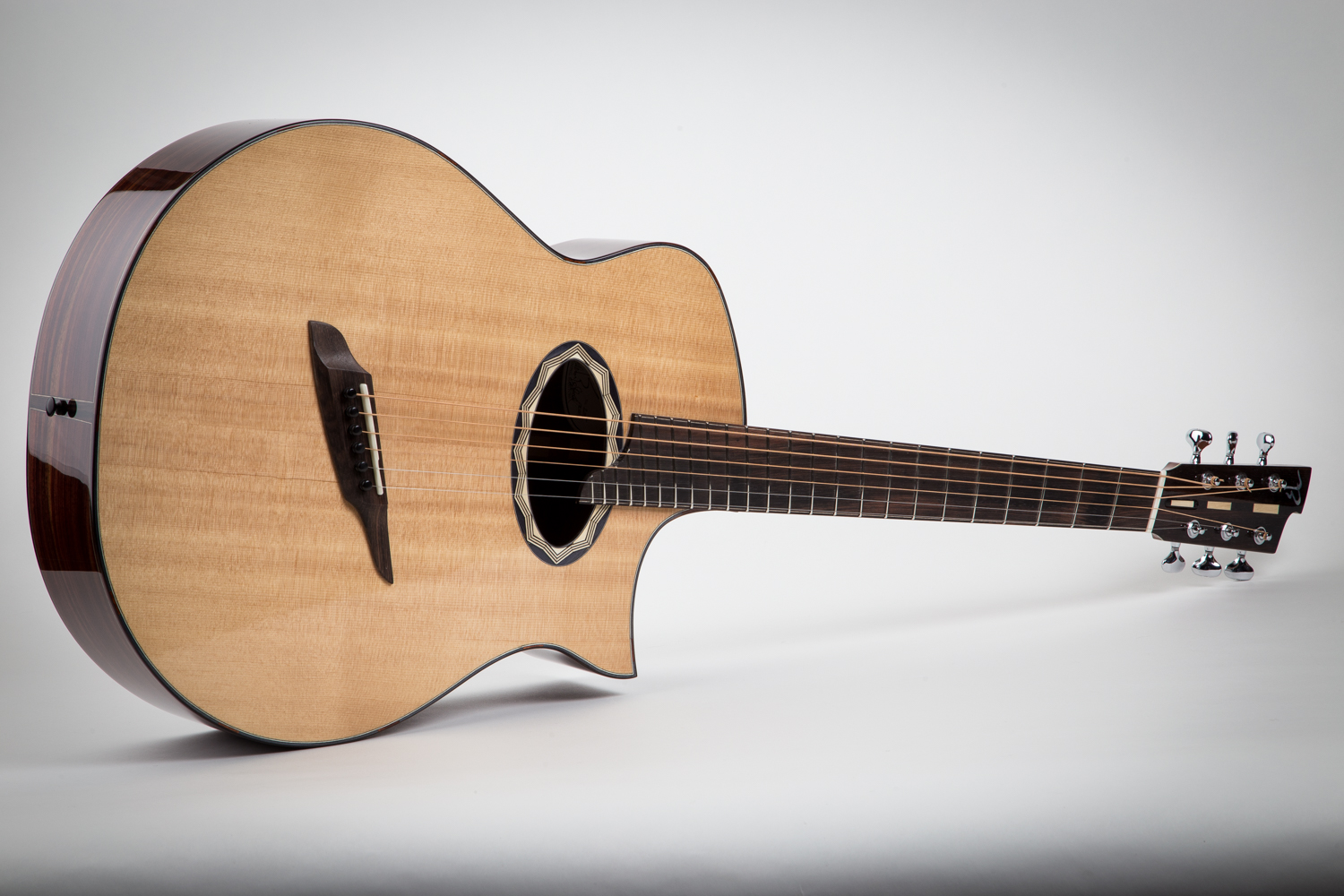 "Model 3D-ms    indian rosewood back and sides, sitka spruce top, macassar ebony, 24.9- 26"" scale"