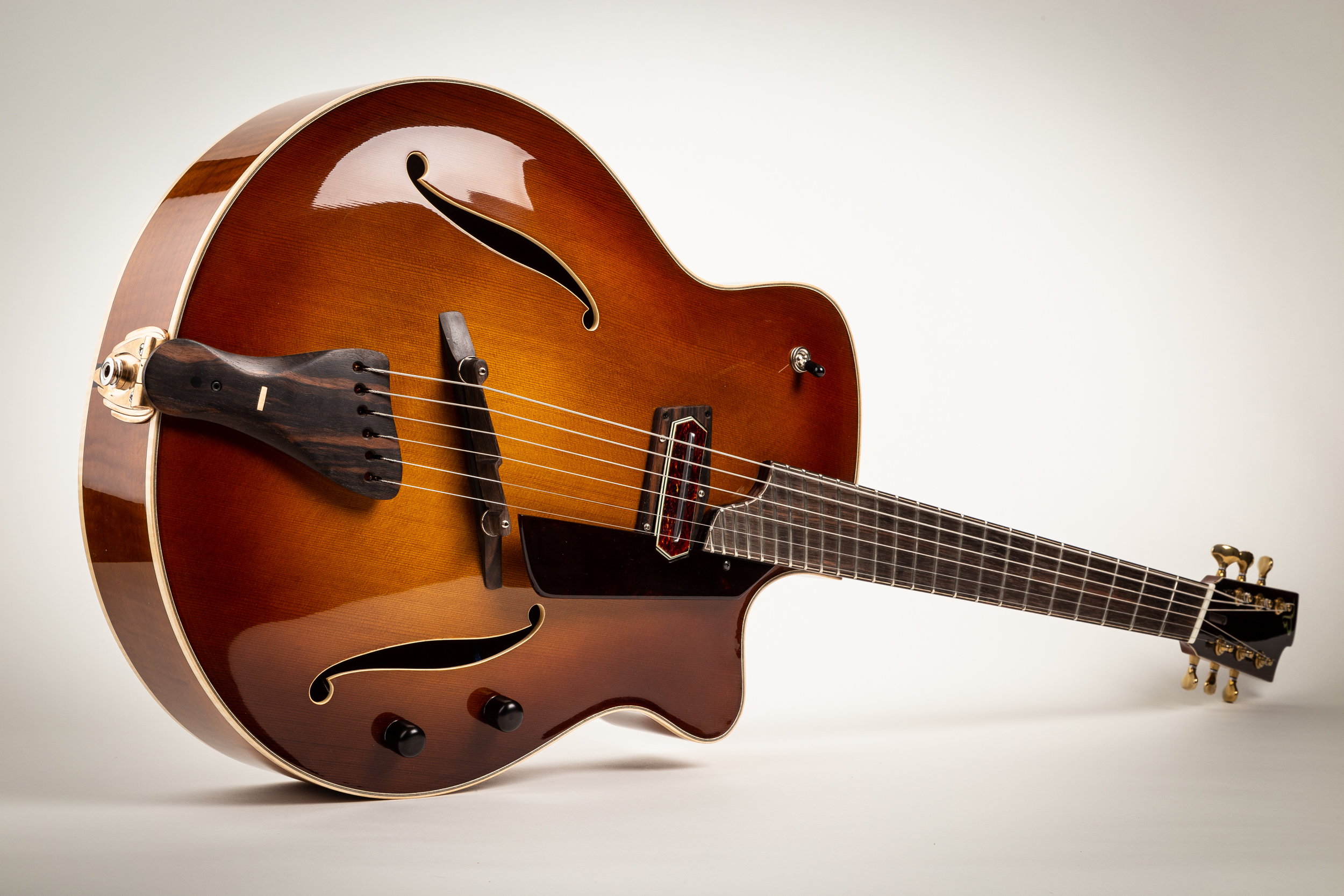 Multi-scale jazz box with sunburst cedar top, maple back & sides. Check this guitar out at  Bluedog Guitars in Vancouver.