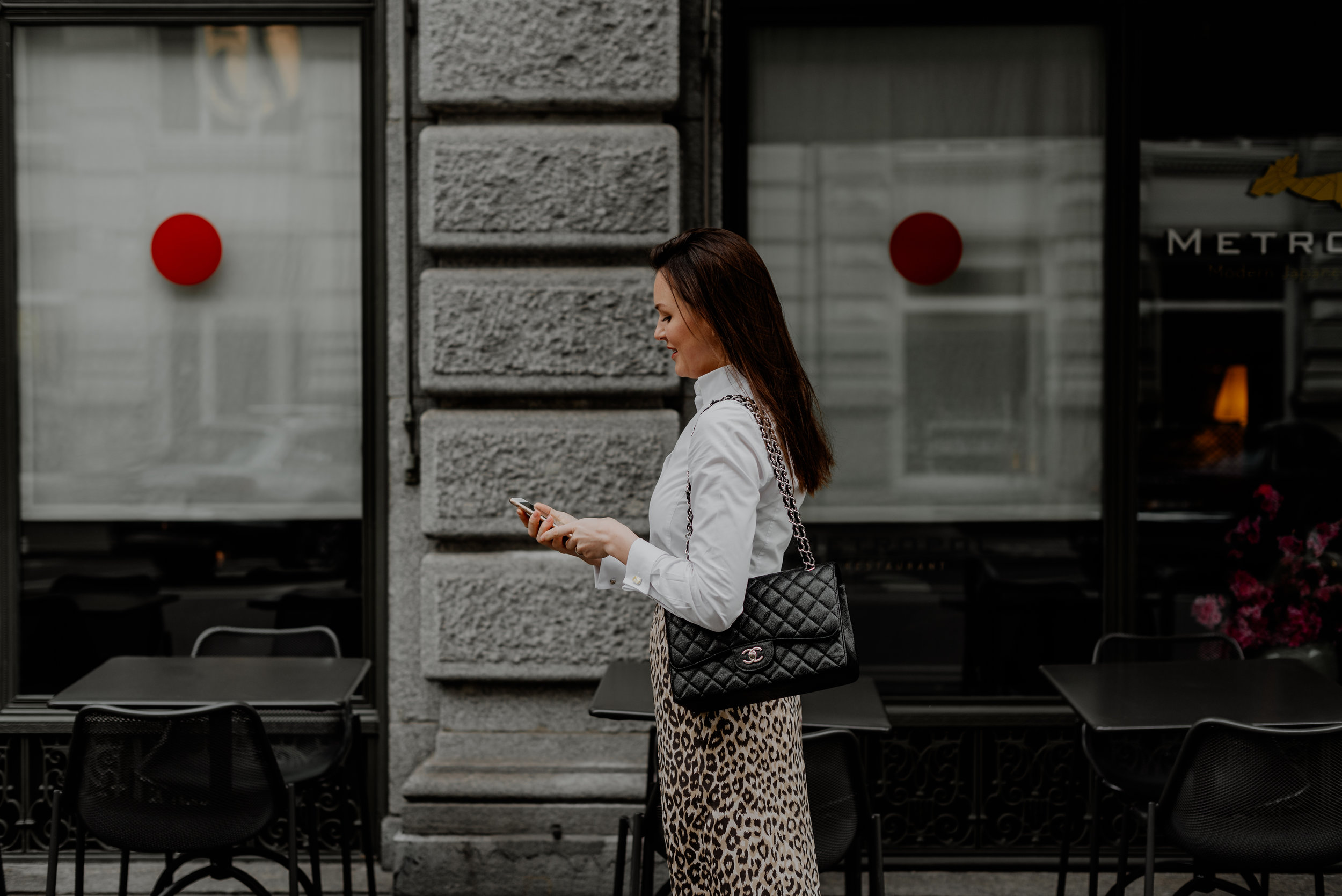 Matching my white shirt, leopard skirt and black Chanel bag.
