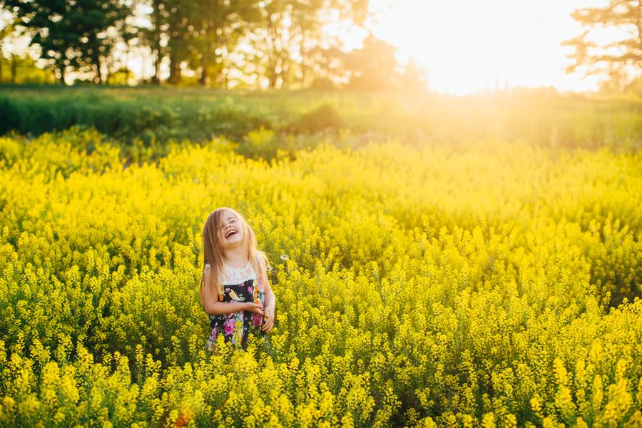 laughing-girl-sunlit-yellow-field.jpg
