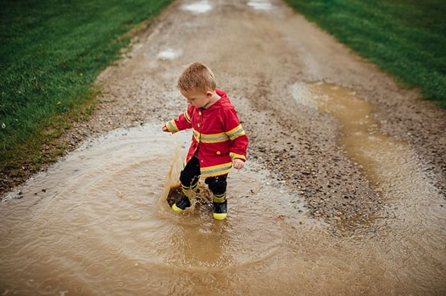 He loves his firefighter rain coat, wants to be just like daddy 🚒⠀ .⠀ .⠀ .⠀ .⠀ .⠀ .⠀ .⠀ #studiophrene #studiophrenelifestyle #mykids #SethandChaya #muddypuddles #puremichigan #rainyday #lookslikefilmkids #dearphotographer #jj_its_kids #candidchildhood #magicofchildhood #documentyourdays #gooutandshoot #momtog #