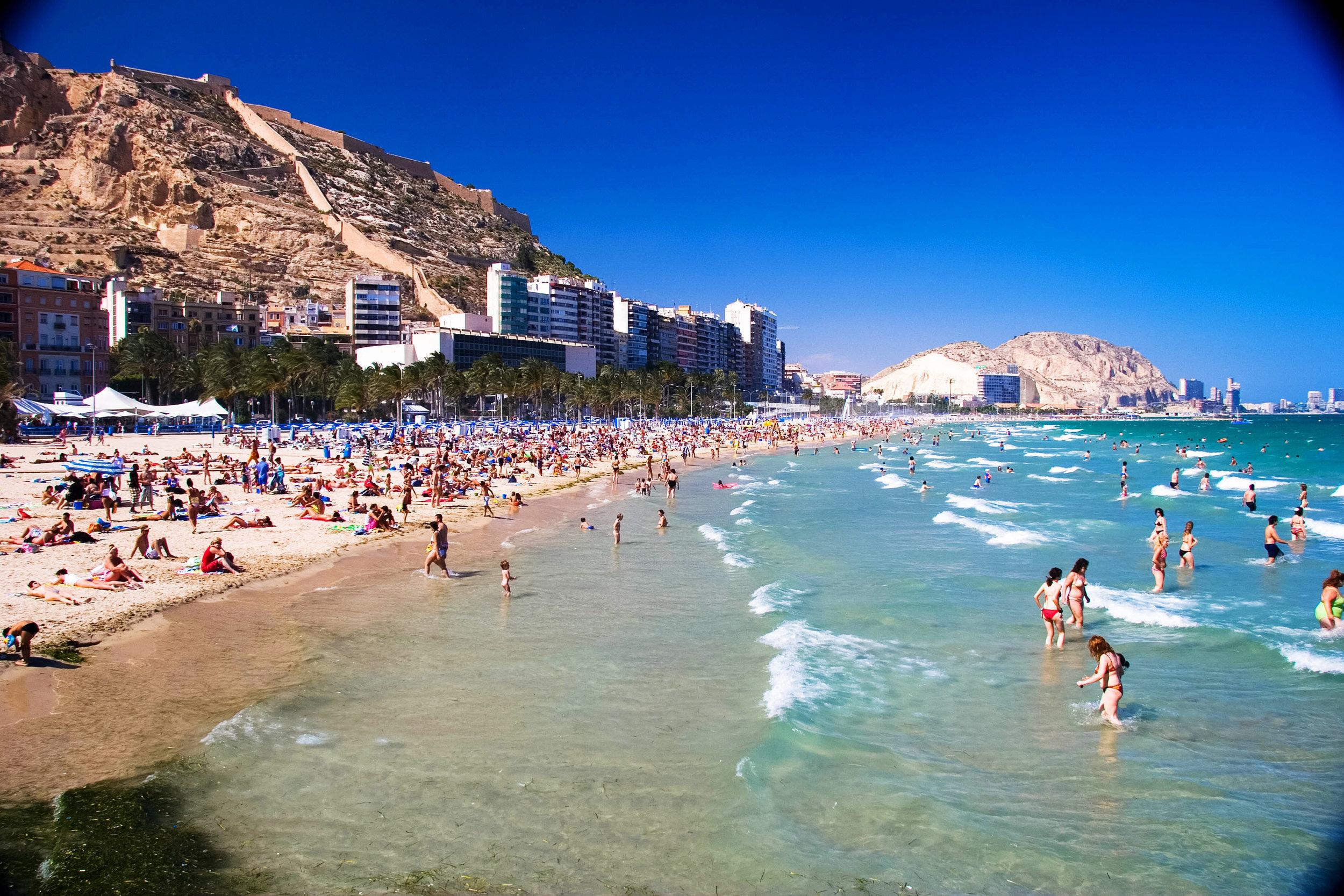Mid day swim on the public beach. Alicante, Spain