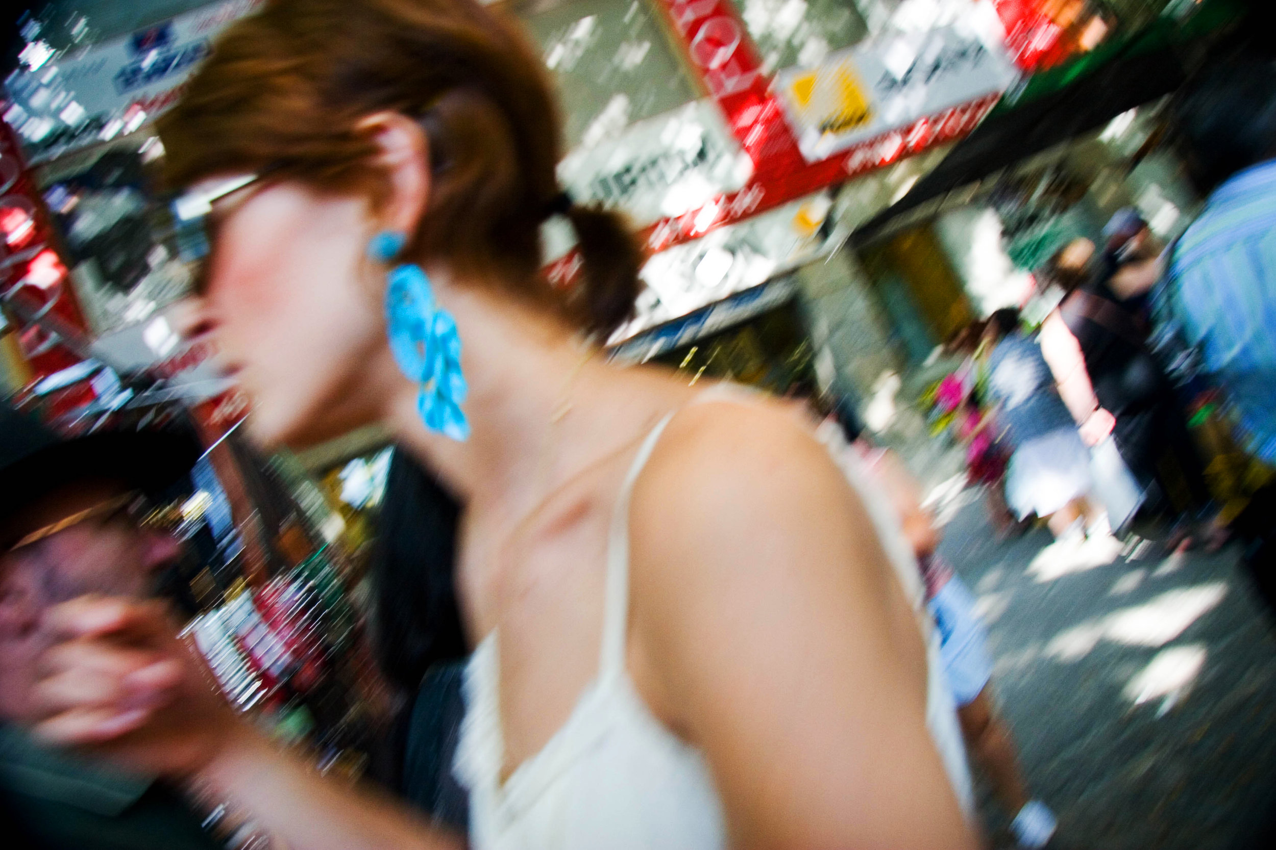 Girl with a blue earring. Rastro Market. Madrid