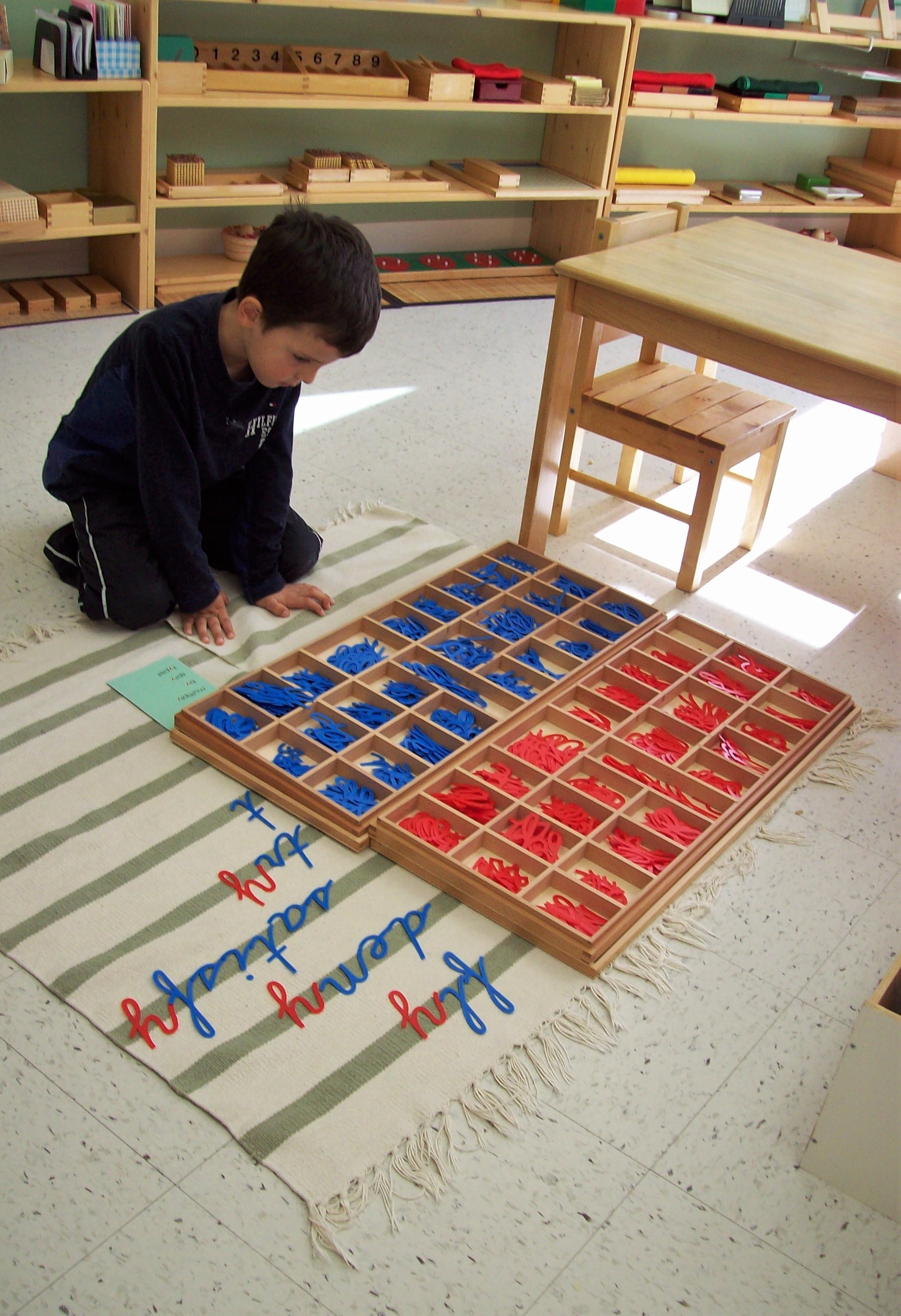 Child in senior class learning letters independently at Kaban Montessori in Mississauga