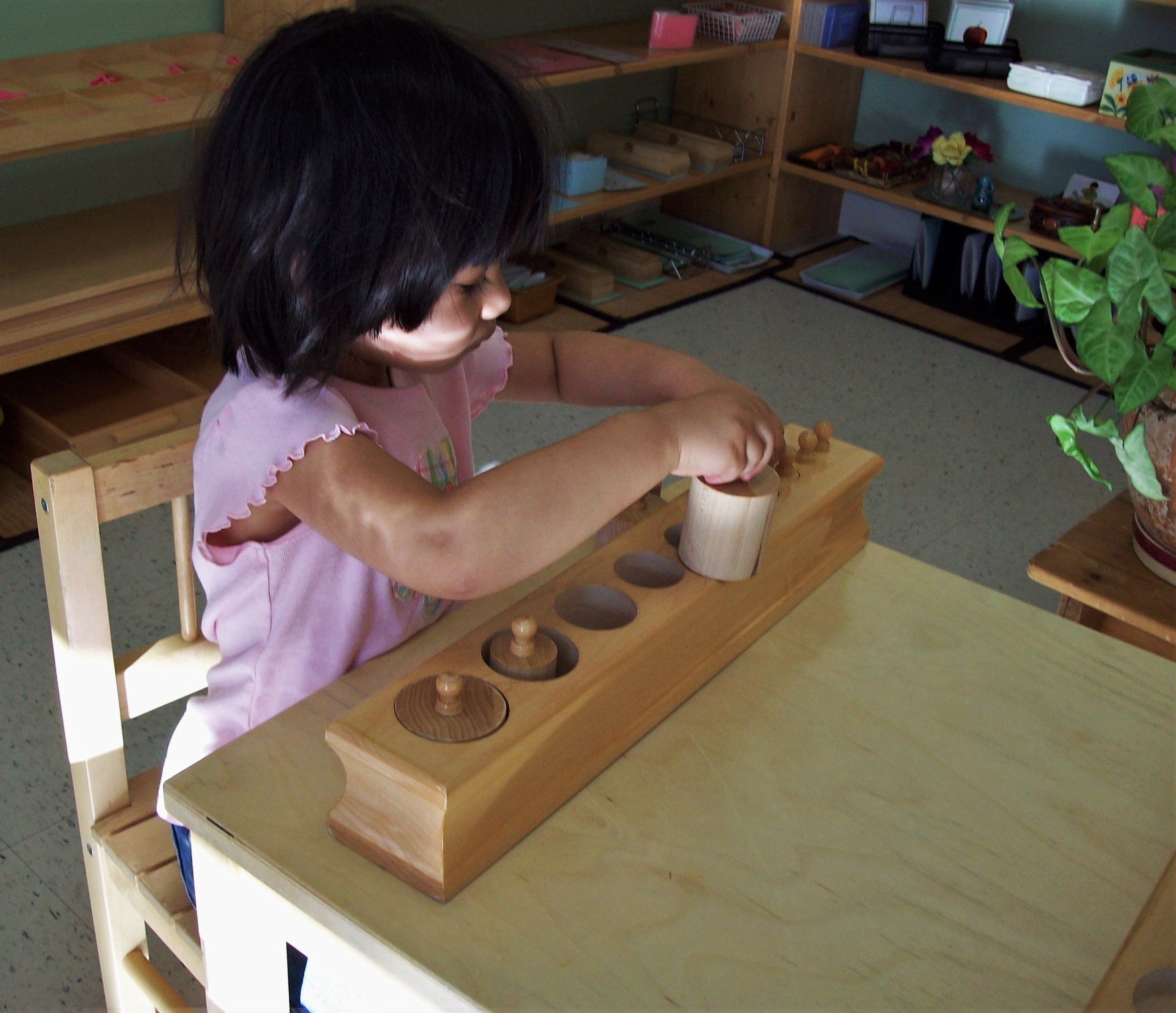 Child learning shapes and sizes  in Casa classroom at Kaban Montessori in Mississauga