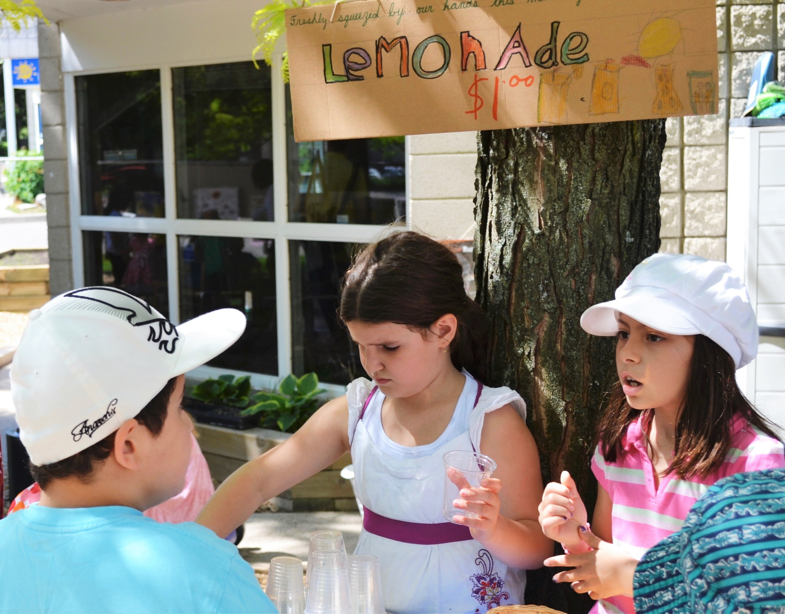 Running a lemonade stand in playgrounds at Kaban Montessori School in Mississauga