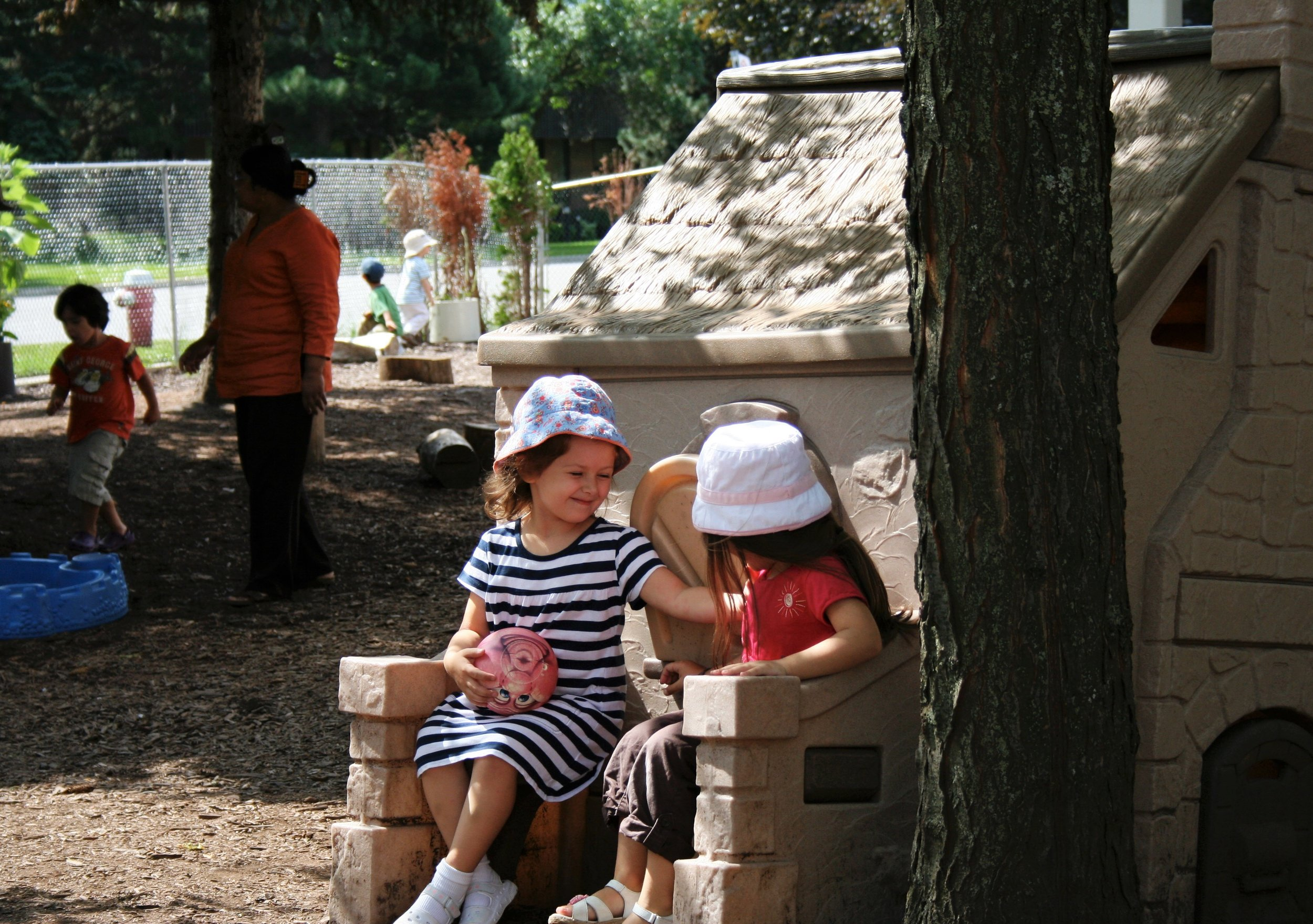 Children talking in school playground at Kaban Montesssori in Mississauga.