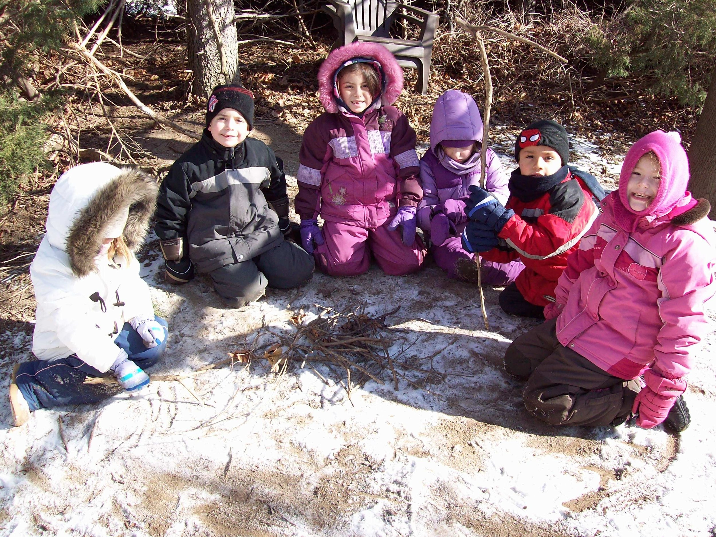Outdoor fun in snowat Kaban Montessori in Mississauga.
