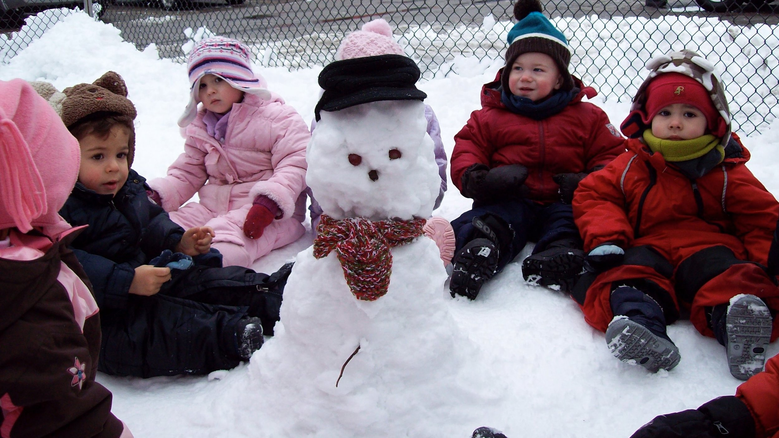 Building a snowman together at Kaban Montessori in Mississauga.