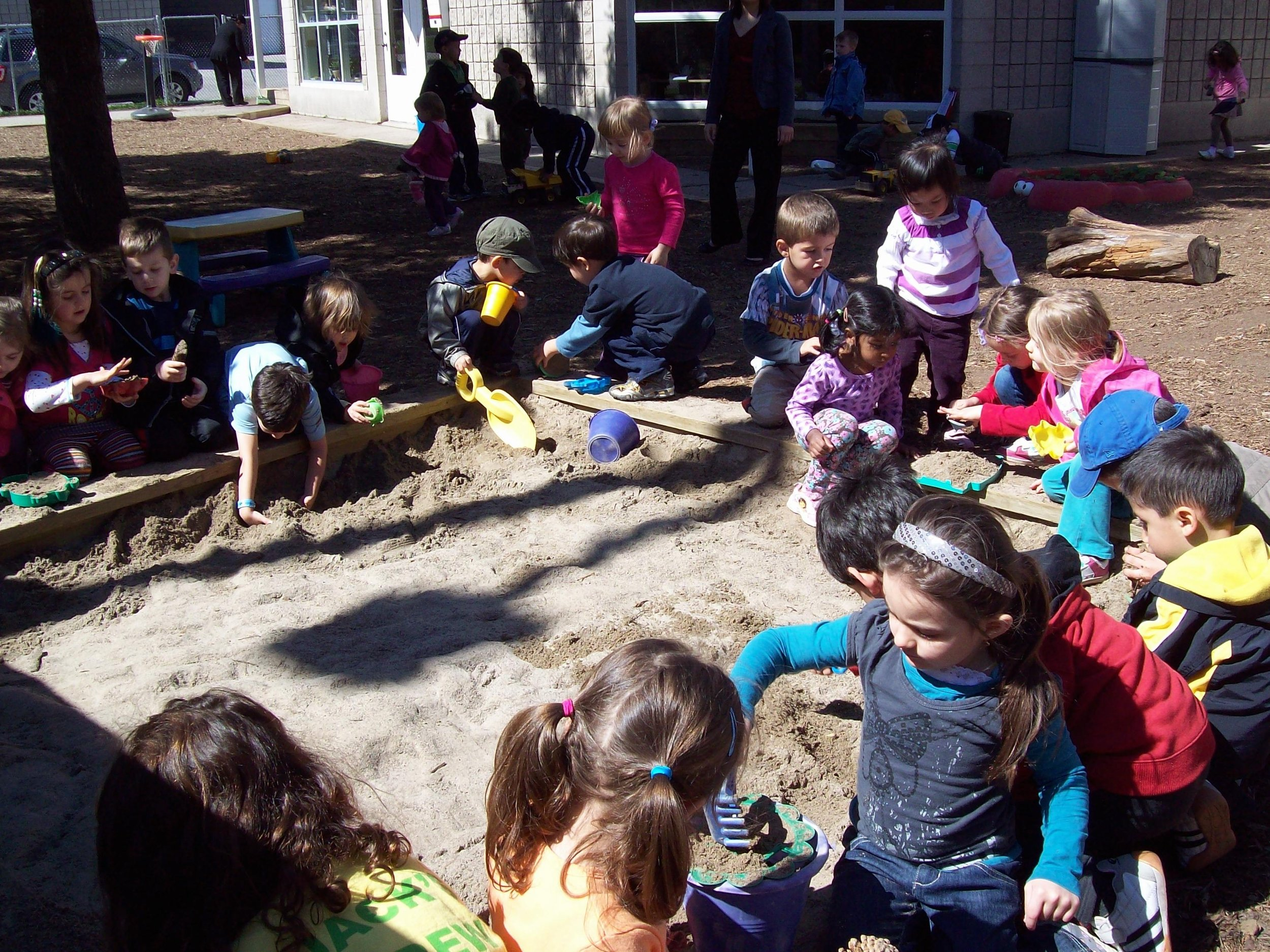 Playing in the school grounds at Kaban Montessori in Mississauga