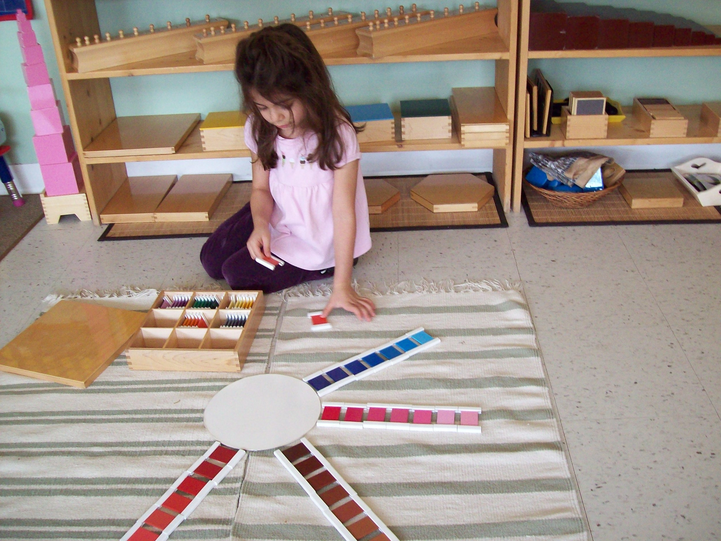 Child learning different shades of colours at Kaban Montessori at Mississauga.