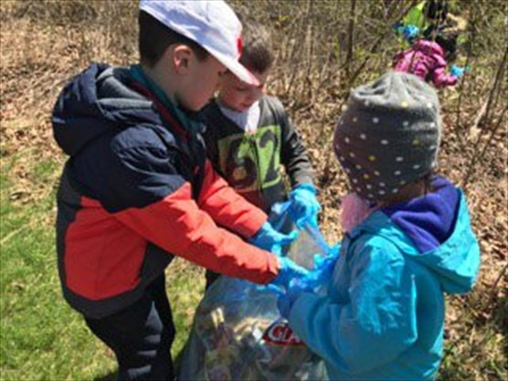 Kaban Montessori in Mississauga - Children collecting trash during annual clean up in Brookmede Park