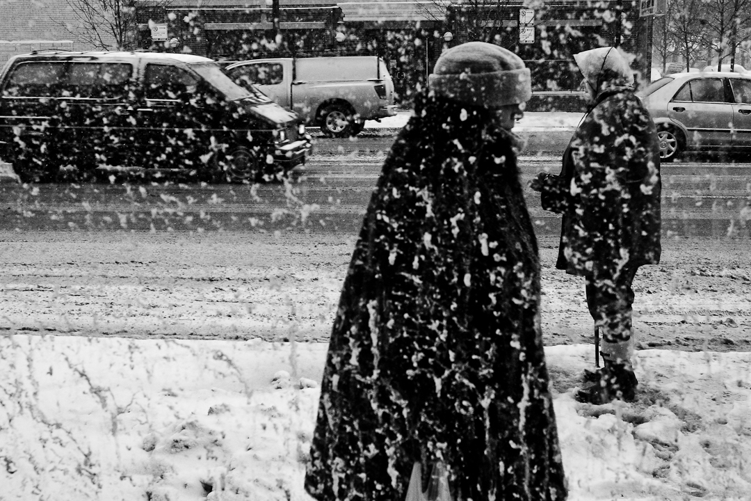 Pedestrians walk through heavy snow in middle of winter on Irving Park Rd. in Chicago's Portage Park neighborhood. Photography by Eddie Quinones.