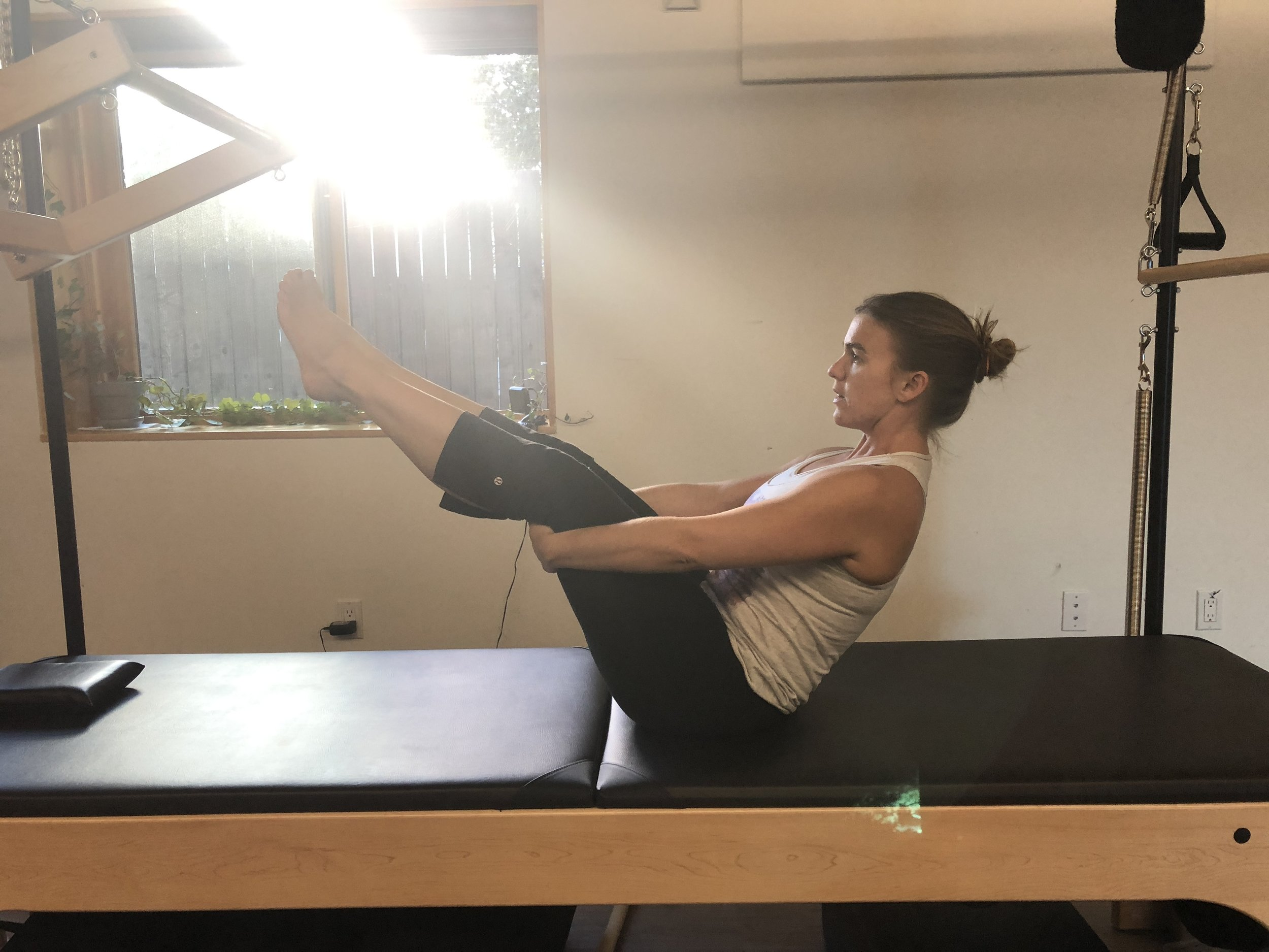 Double Leg Roll Up - Similar to the single leg roll up but with both legs in the air (you can also use a towel around the feet or keep the knees bent if you have tight hamstrings), again try to balance half way up.