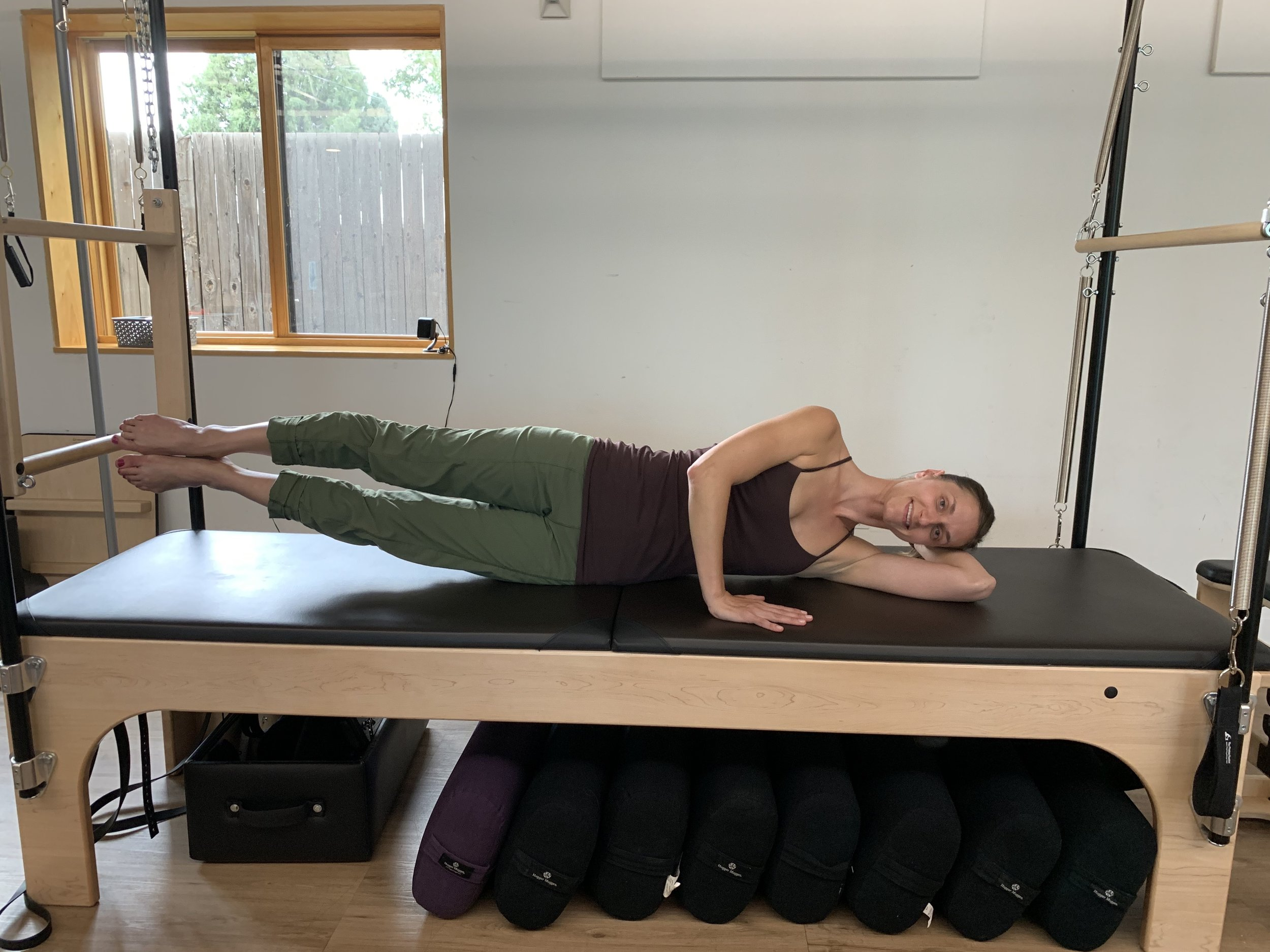 The Pilates Collective Denver - side-lying leg lifts.jpg