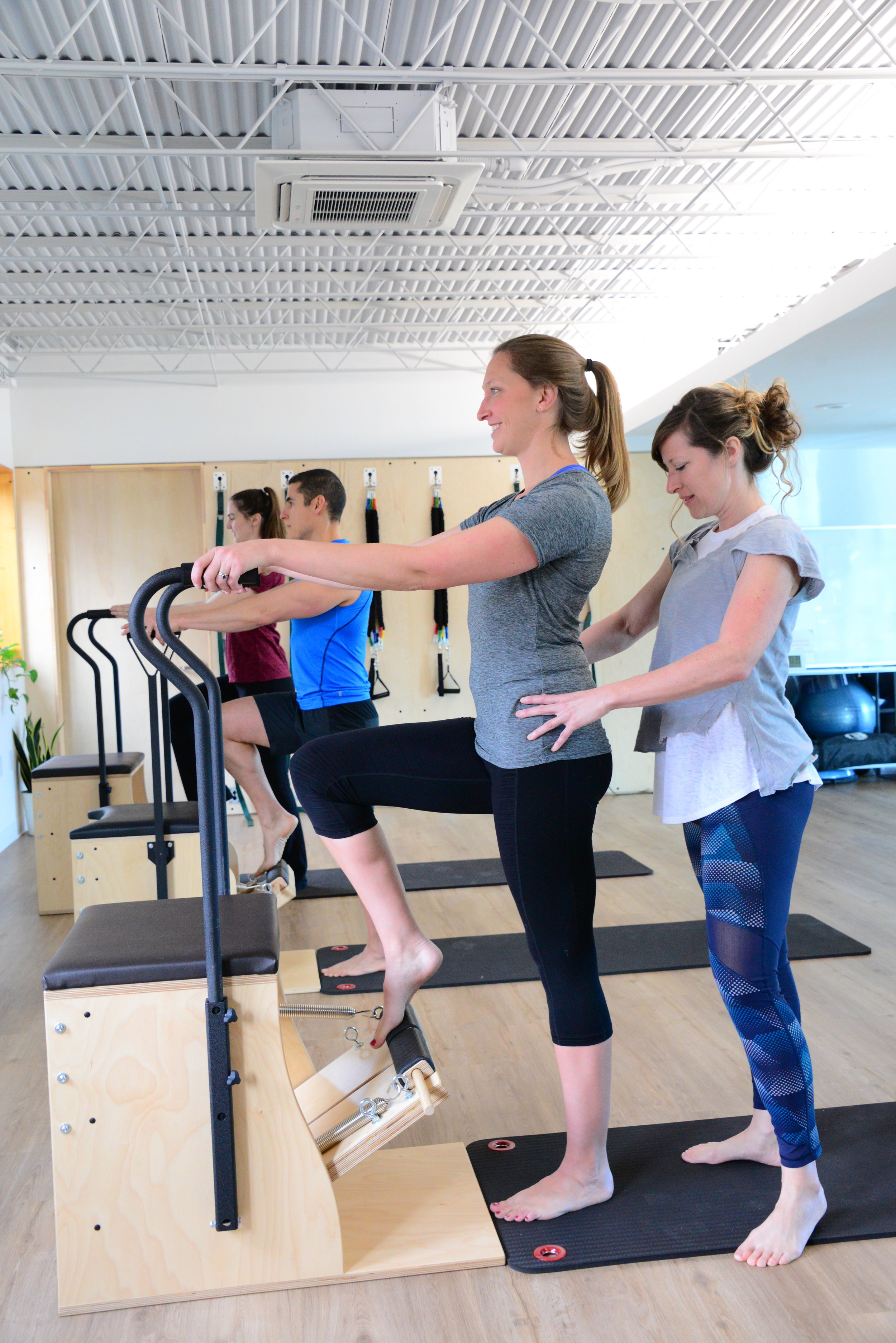 The Pilates Collective Denver - Pilates for Runners, footwork on chair