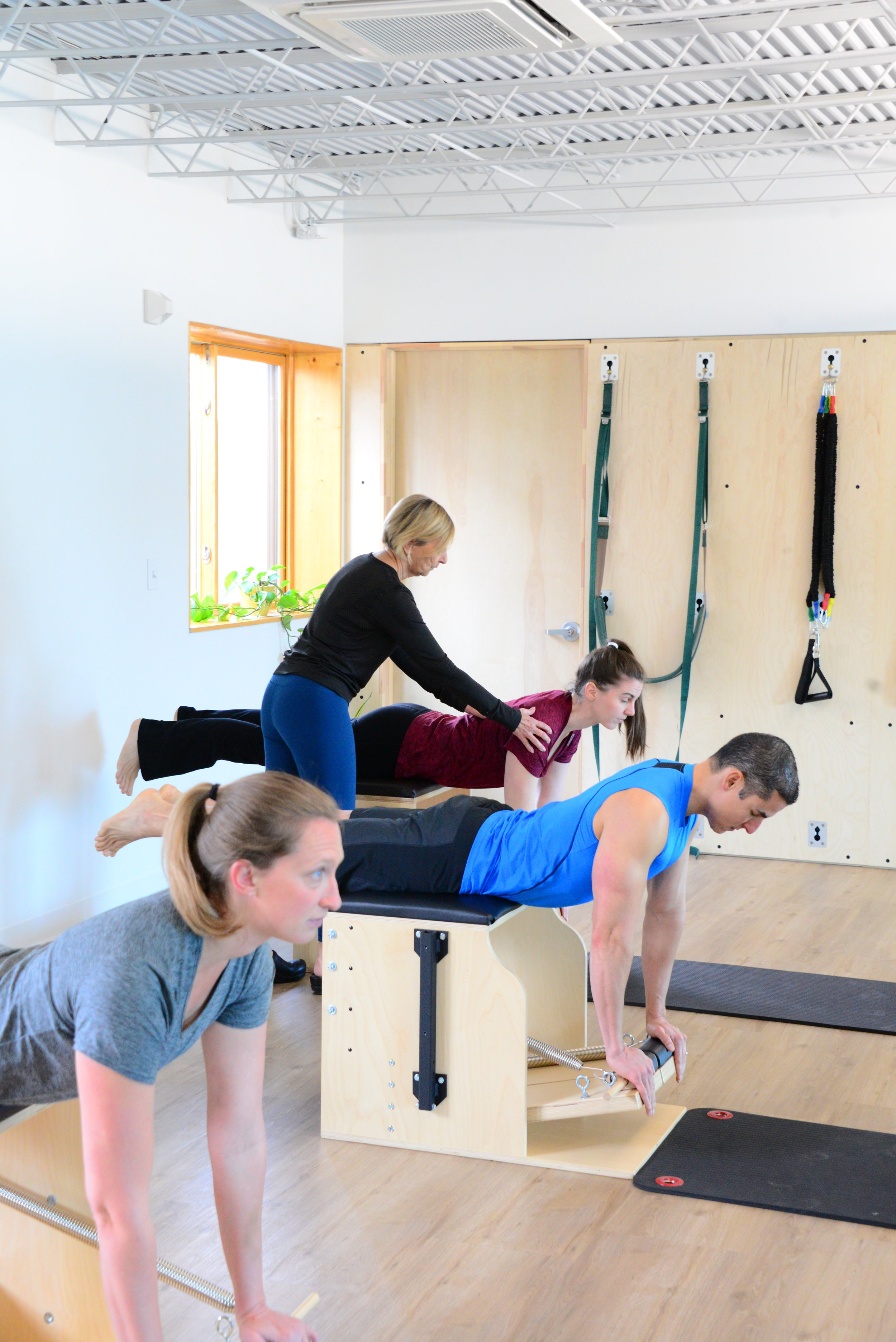Ann is doing back extension on the chair, which is similar to using the long box on the Reformer