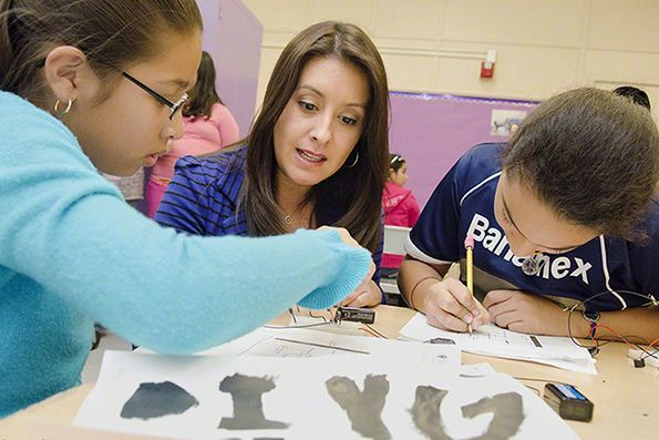 Lori Castaneda (Left) with DIY Girls founder Luz Rivas (Middle) during the first Creative Electronics Program at Telfair Elementary in 2012.