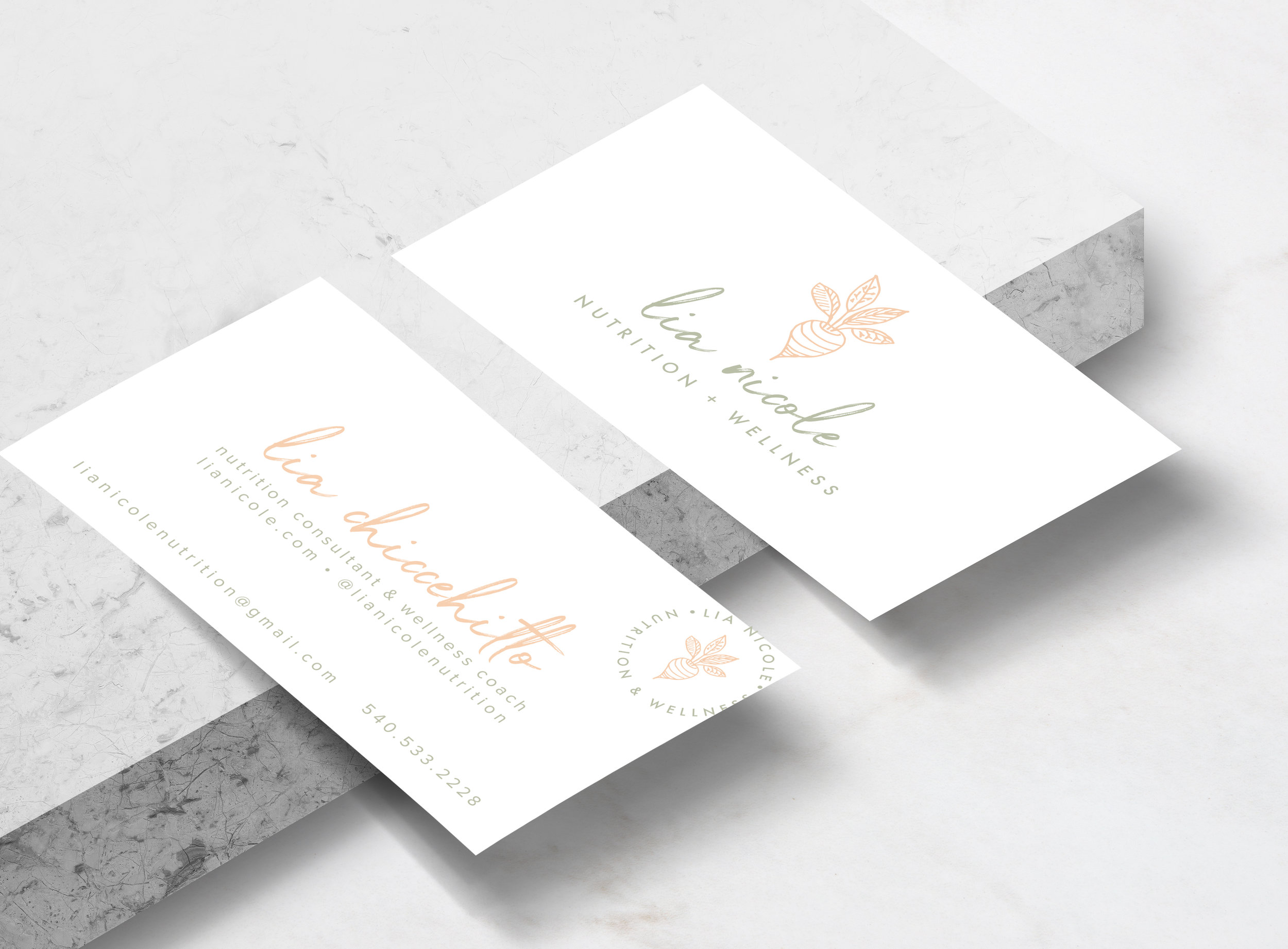Pretty pastel feminine light peach and mint business cards with a script calligraphy cursive logo designed by Gretchen Kamp for a nutritionist in San Diego. To view the full project click here: http://www.gretchenkamp.com/lia-nicole-nutrition
