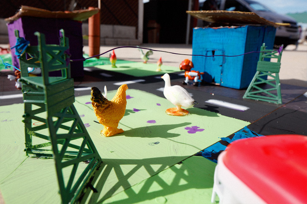On the adjacent tile, houses now have solid roofs, chickens and other animals roam the gardens, and streets are paved.