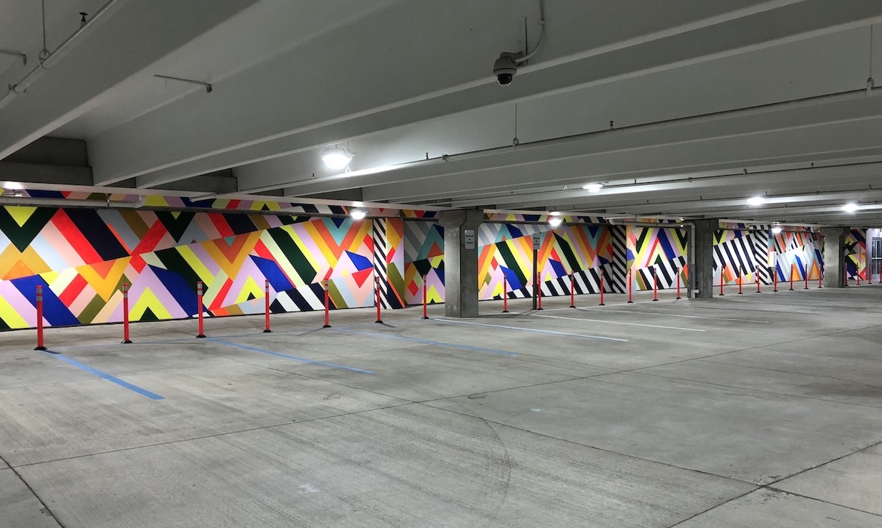 The Dazzle Colonnade , 2018  Paint on concrete and wood  Depot Garage at Promedica Headquarters, Toledo, OH