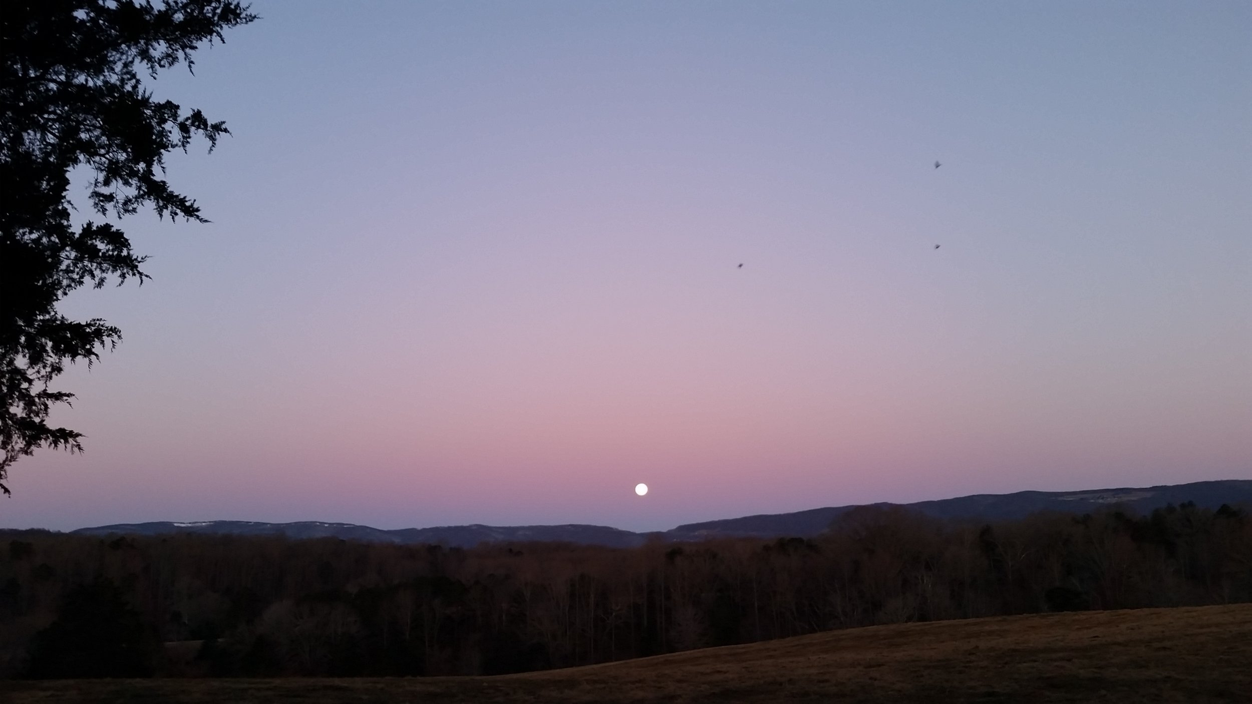 full moon setting over rockfish gap
