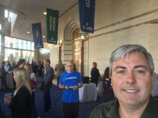 Rev1 Ventures DemoDay 2016. I'm expanding, exploring and enjoying.  Great afternoon hearing startup stories and their inspirational tales of success. Photo taken in the lobby of the Riffe Center. This gentleman in the blue is unwittingly photobombing without a bit of effort - he just is. You'll be able to read more about this new business phenomena in Columbus Business First this Friday. Missed Demo Day? See the replay here: bit.ly/R1DDLivestream